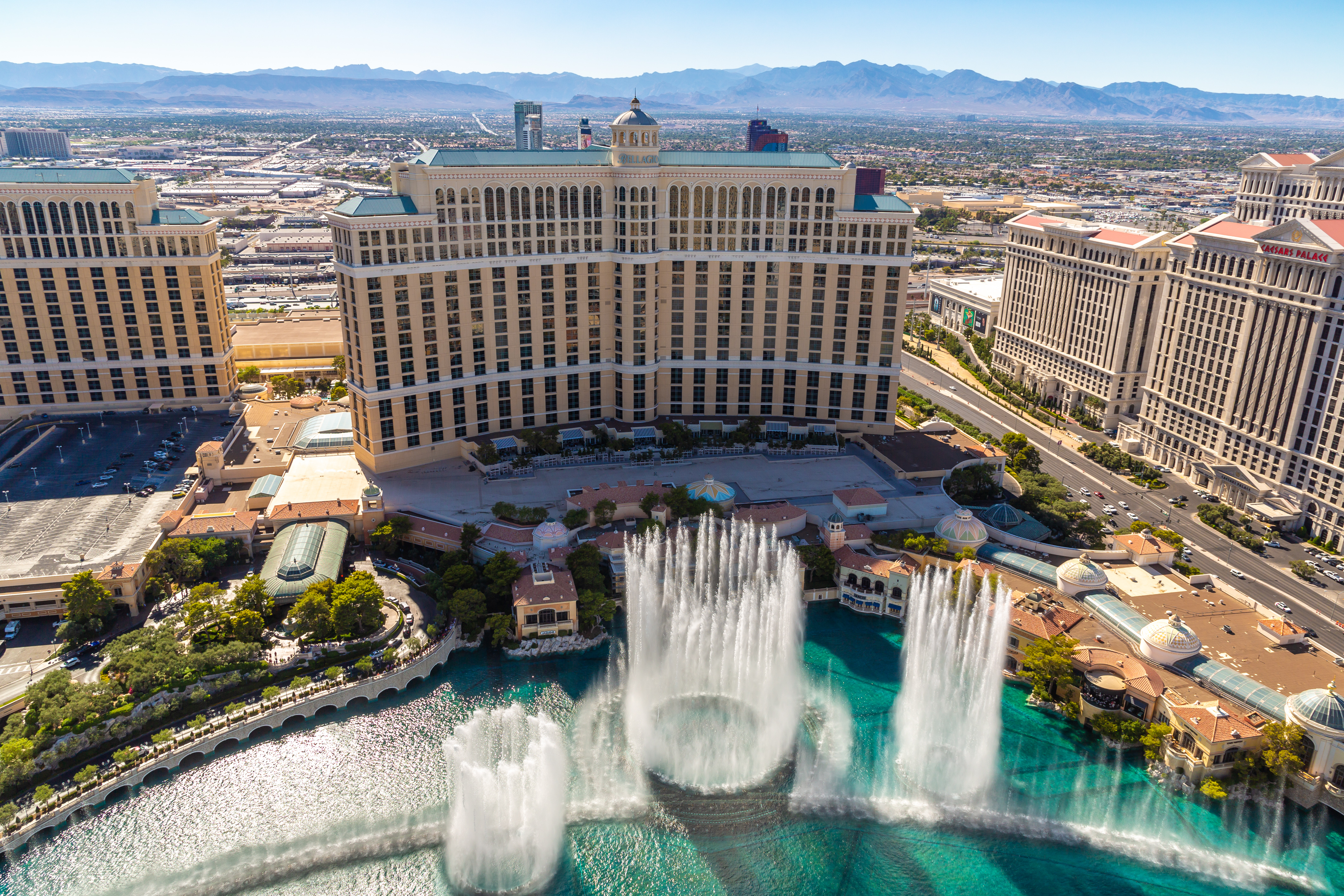 An overhead view of a hotel with fountains in front