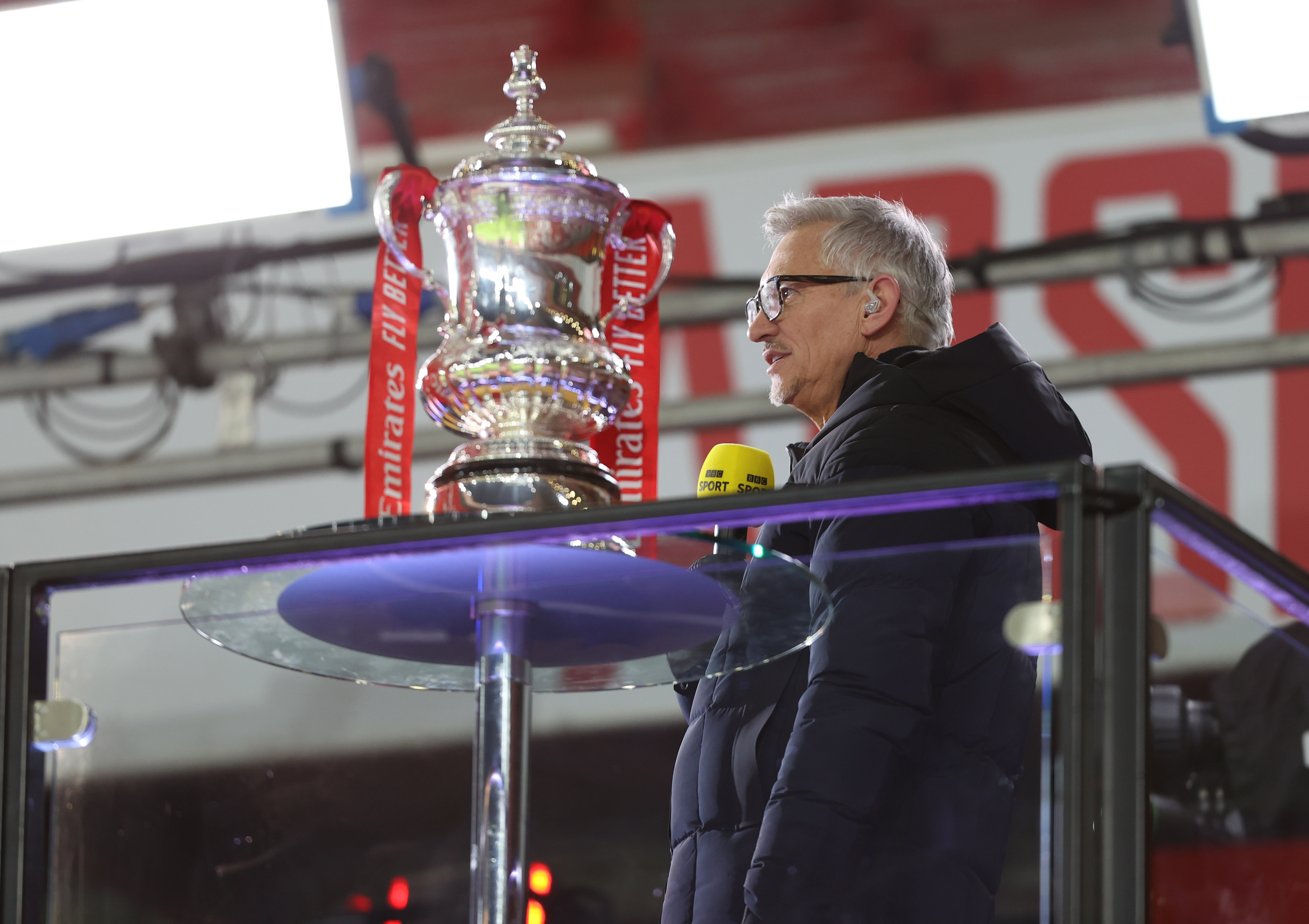 Gary Lineker standing at the FA Cup trophy