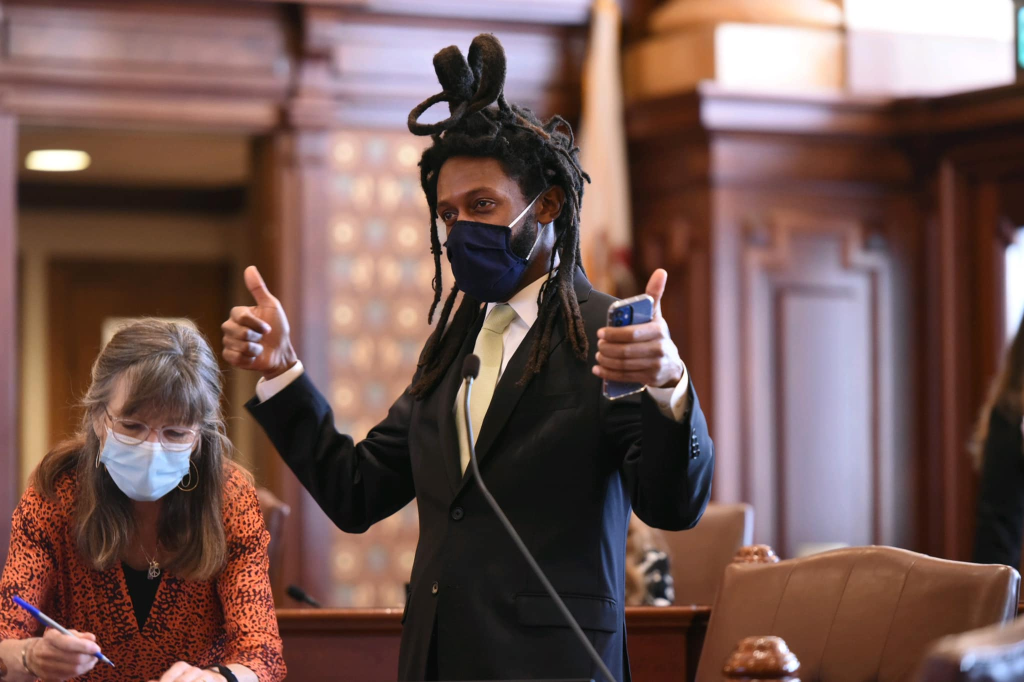 State Sen. Mike Simmons, D-Chicago, celebrates passage of a bill he sponsored last month.