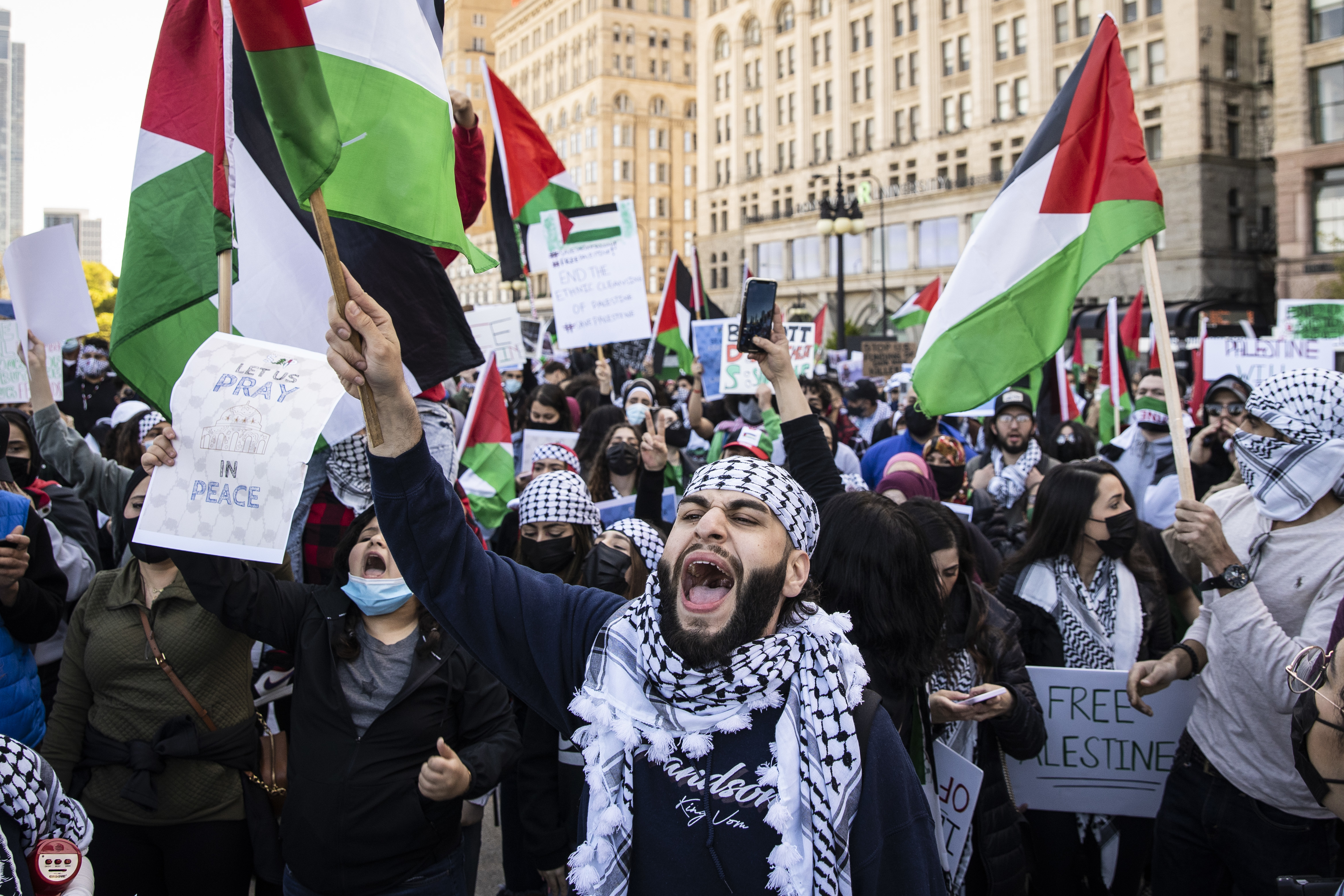 Thousands rally Wednesday on Michigan Avenue near Grant Park in support of Palestinians in the Middle East.