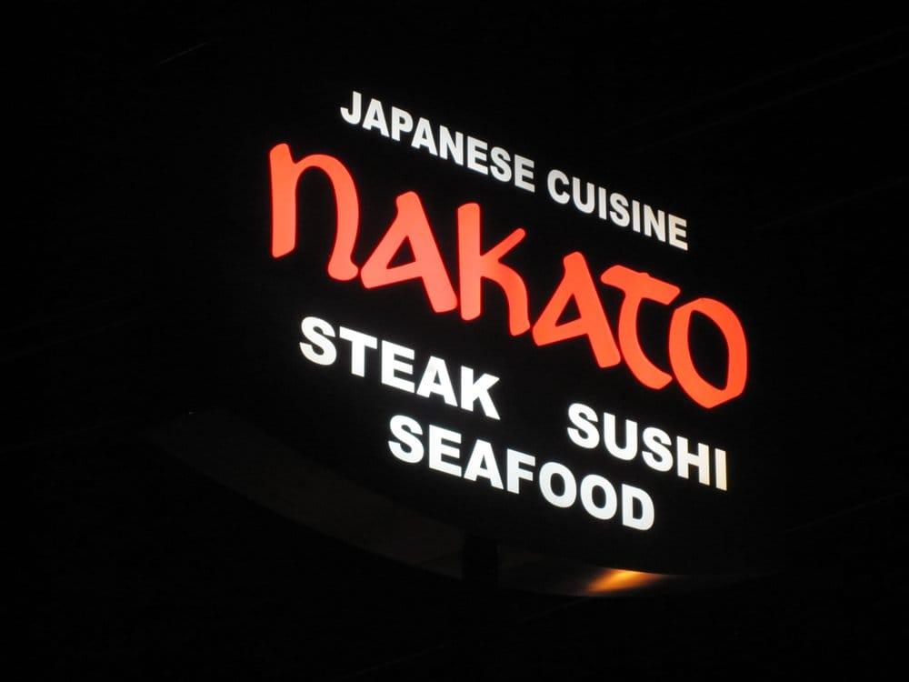 The Nakato Japanese restaurant sign lit up in the dark in Atlanta