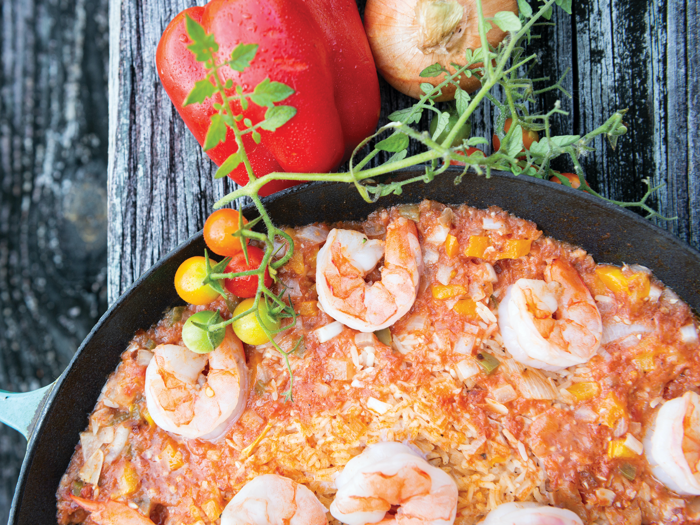 A shrimp and rice dish in a pan