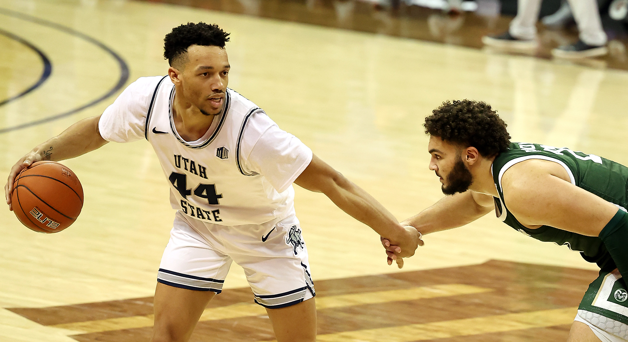 Utah State Aggies guard Marco Anthony (44) looks to get around Colorado State Rams guard David Roddy (21) as their hands come together as Utah State and Colorado State play in the Mountain West Tournament at the Thomas & Mack Center in Las Vegas on Friday, March 12, 2021. Utah State won 62-50.