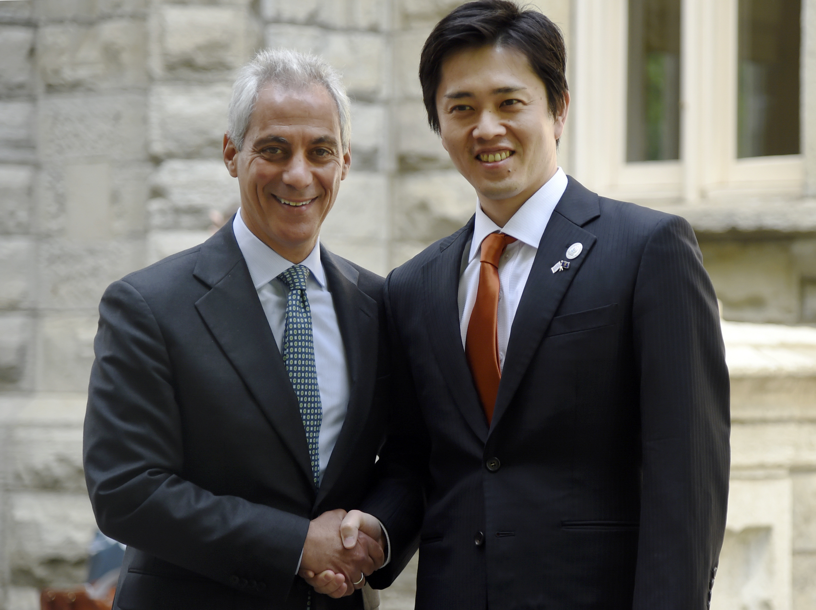 Chicago Mayor Rahm Emanuel (left) shakes hands with Hirofumi Yoshimura, mayor of Osaka, Japan, in June 2018 in Chicago. The mayors met to celebrate the 45th anniversary of the sister city partnership between Chicago and Osaka.