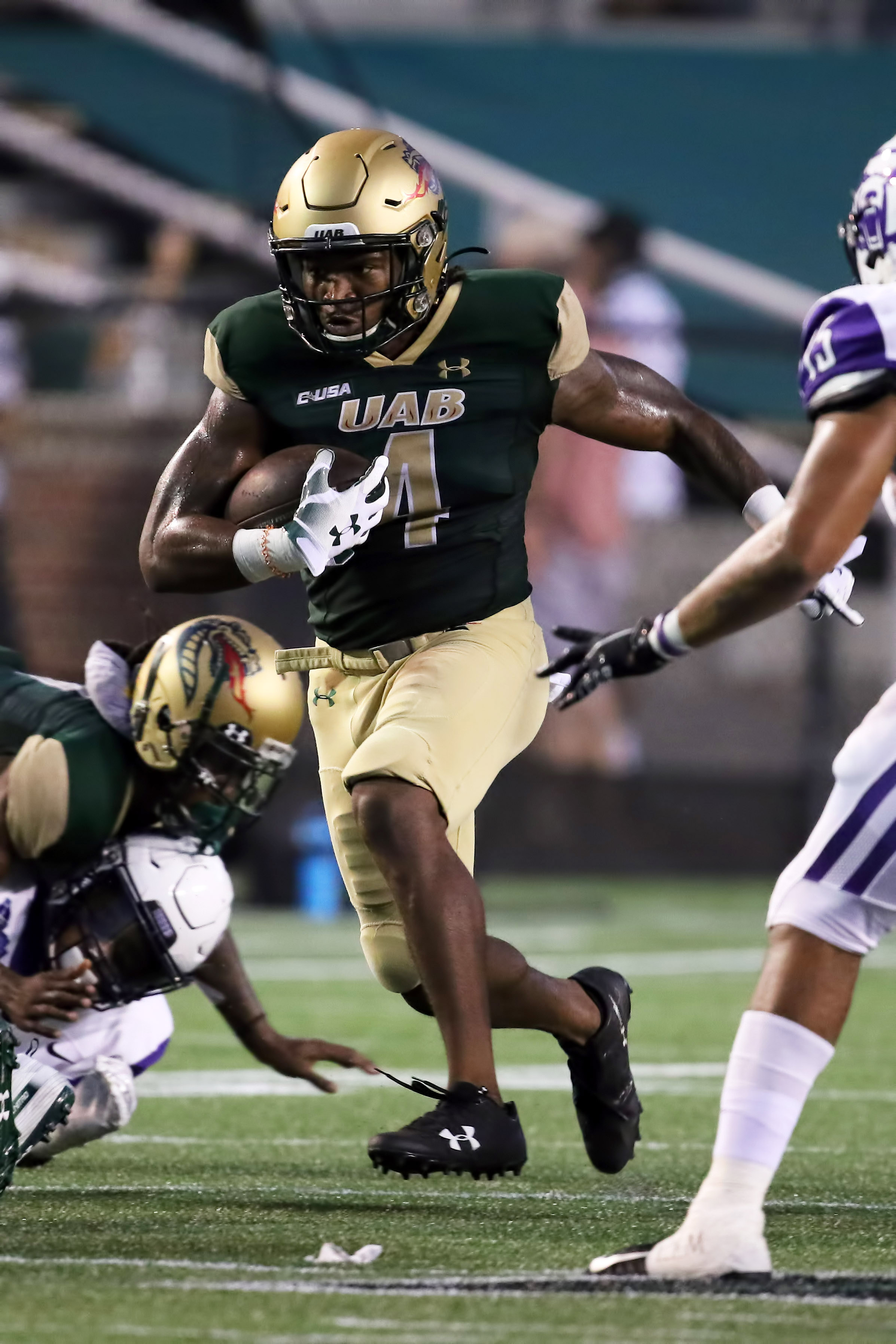 UAB Blazers running back Spencer Brown (4) carries the ball during the college football game between the Central Arkansas Bears and the UAB Blazers on September 3, 2020, at Legion Field in Birmingham, AL.