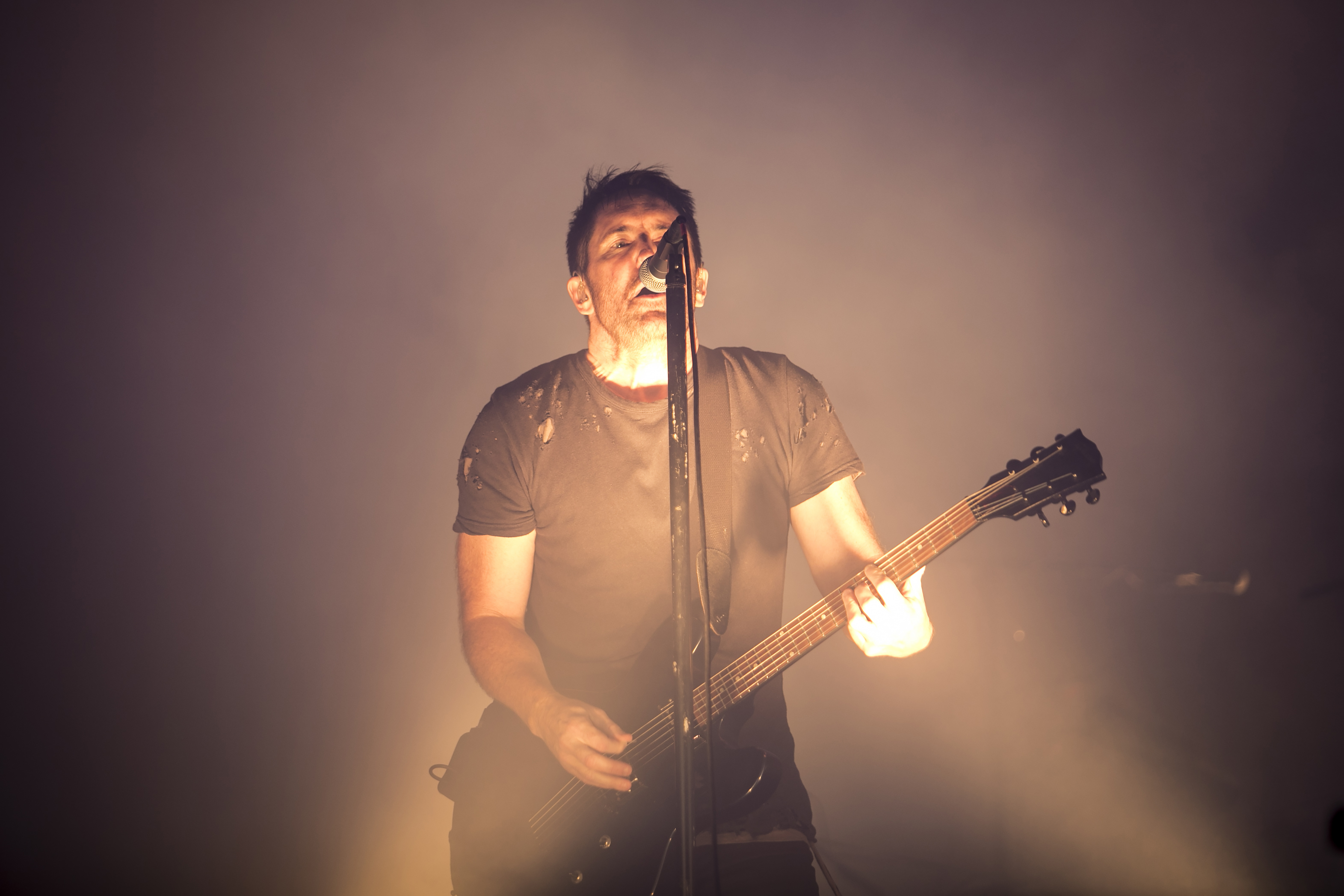 Trent Reznor, of Nine Inch Nails, performs on day one of Riot Fest in Douglas Park, Sept. 15, 2017. The band returns to headline the festival this year.