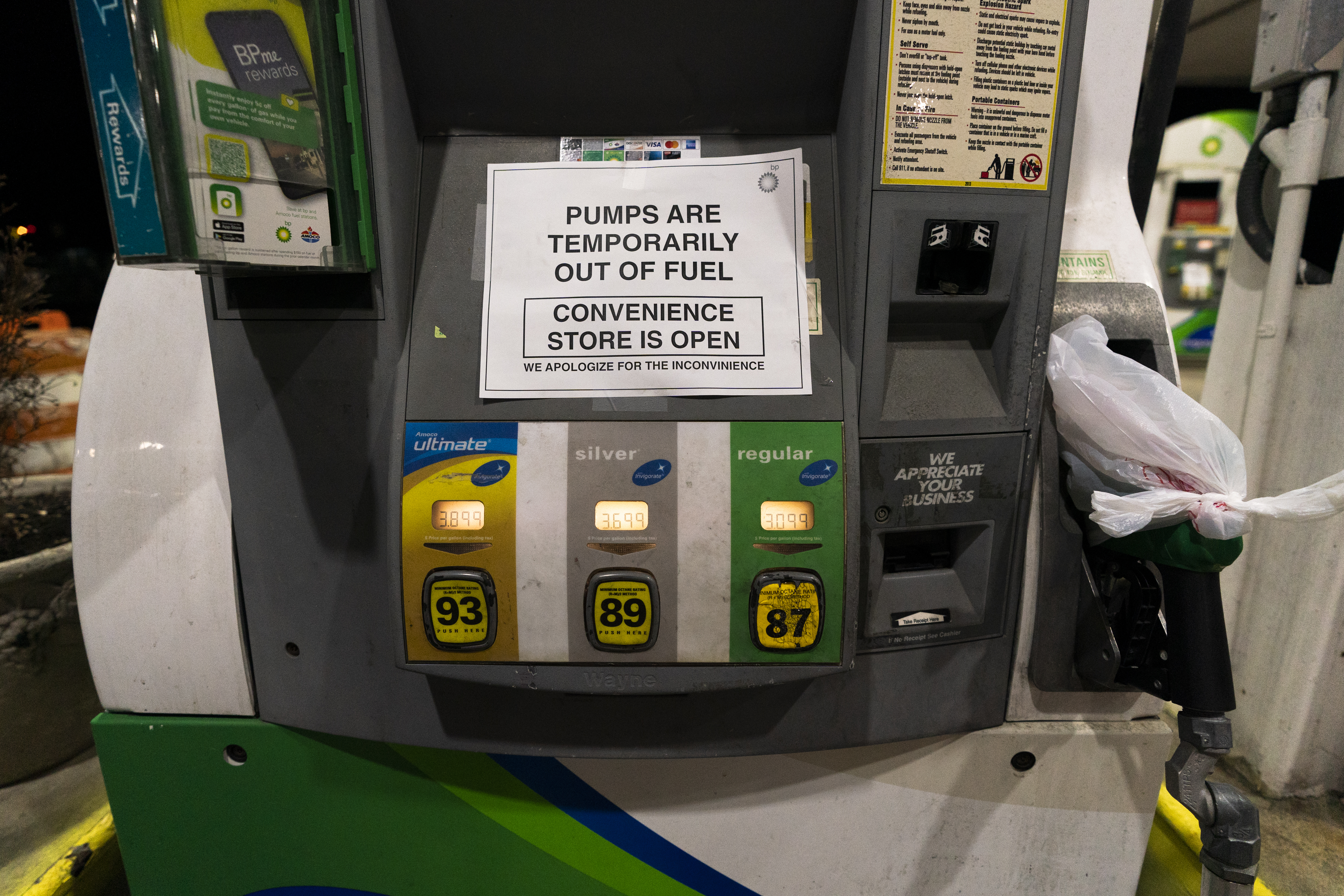 A gas pump at a gas station in Silver Spring, Md., is out of service, notifying customers they are out of fuel, late Thursday, May 13, 2021.