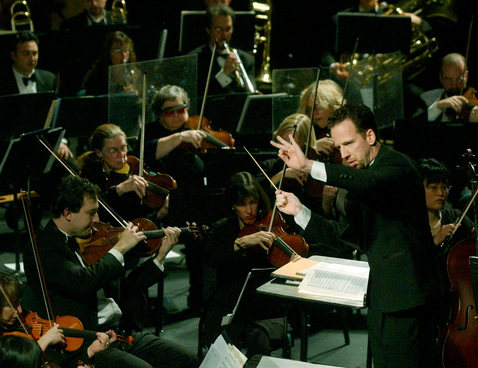 Scott O'Neil conducts the Utah Symphony Orchestra at Abravanal Hall for members of the IOC and their guest. photo: michael brandy. 2/3/02 (Submission date: 03/31/2004)