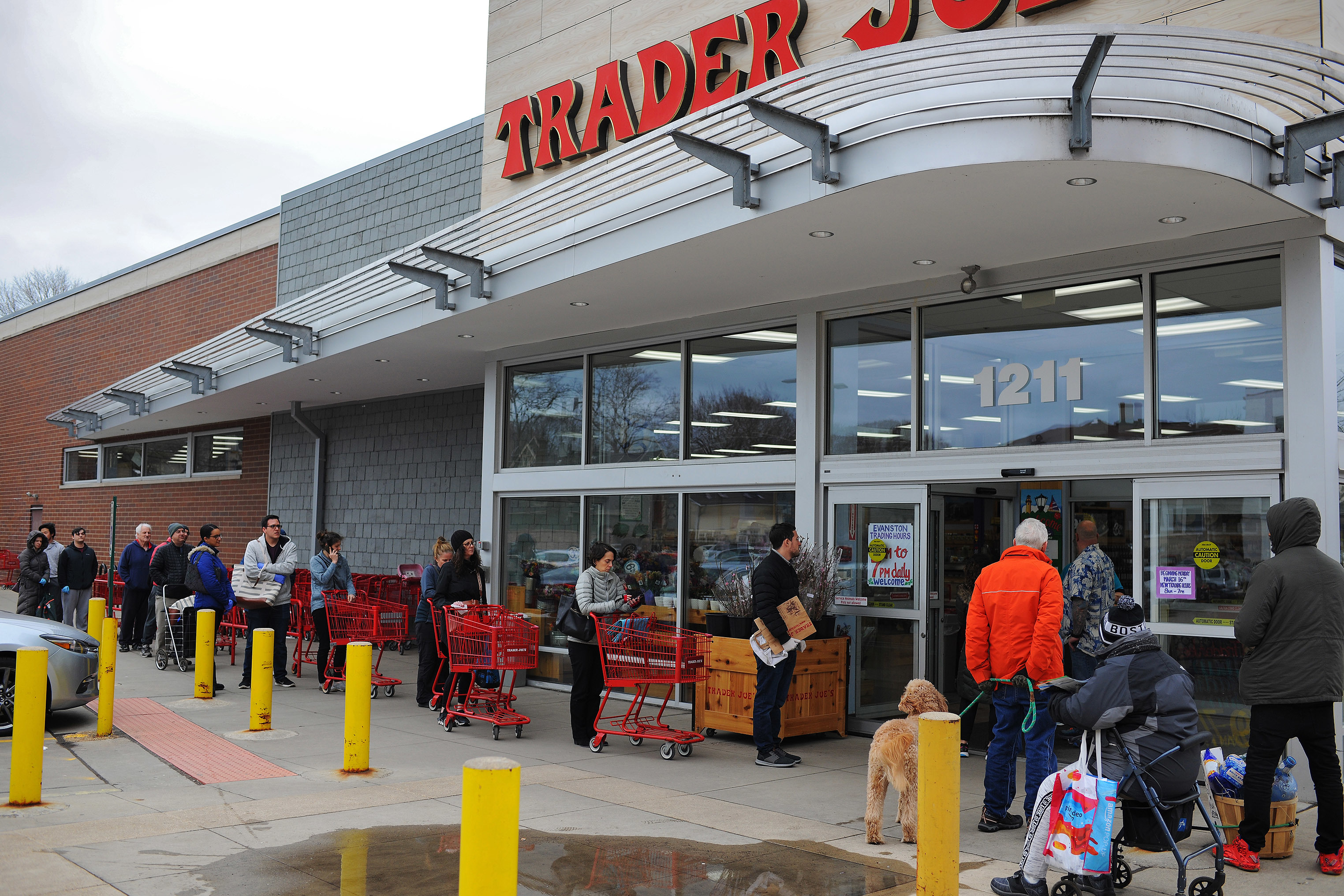 Shoppers line up to get into the the Trader Joe's in Evanston, IL on Friday, March 20, 2020.