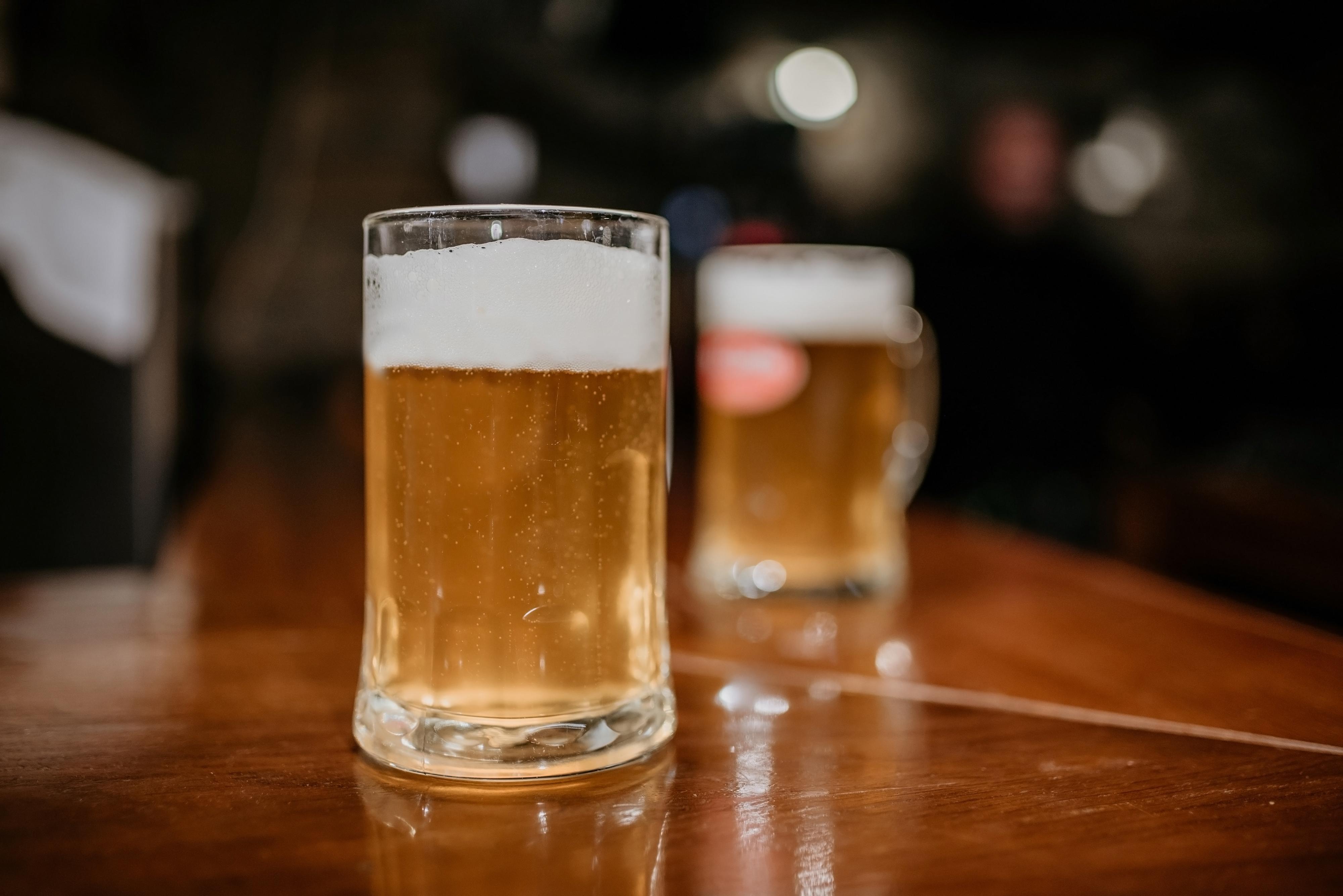 A mug of beer on a wooden bar