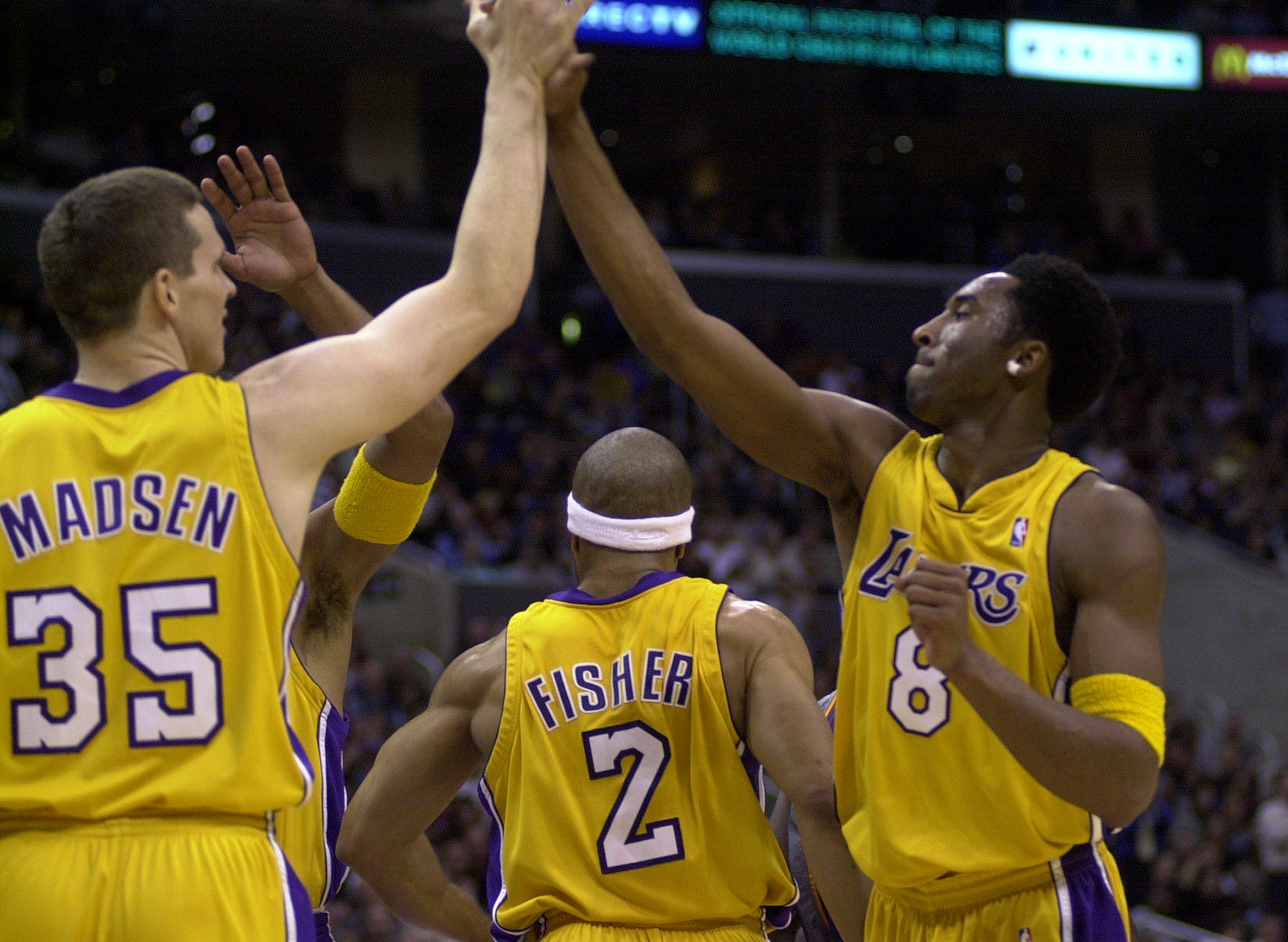 Mark Madsen congratulates Kobe Bryant after Bryant scored in a 2001 LA Lakers game. Madsen and Bryant were teammates for three years.