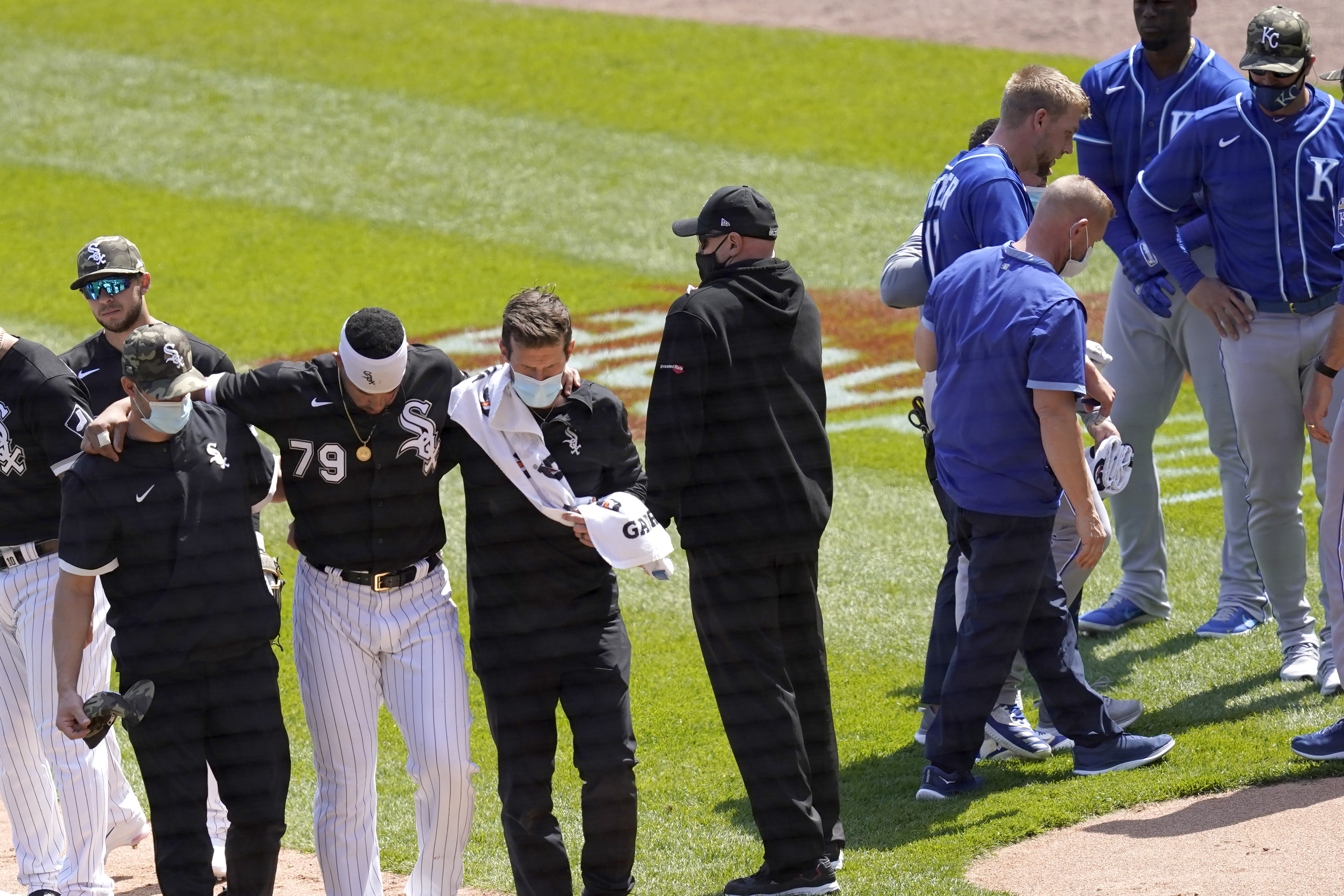 White Sox first baseman Jose Abreu, left, heads to the dugout as the Royals' Hunter Dozier heads to his dugout after they collided along the first base line in the second inning of the first game of Friday's doubleheader.