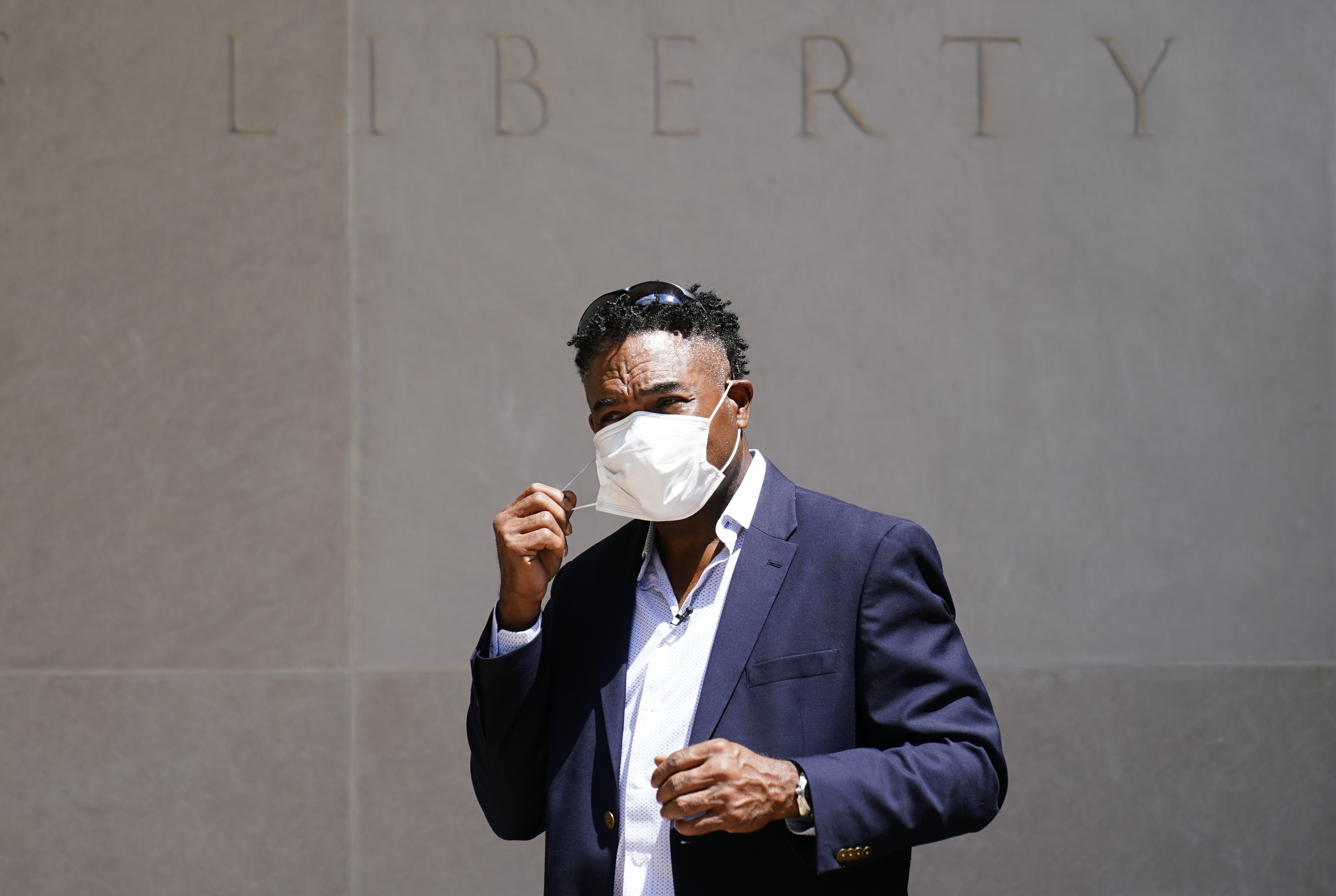 Former NFL player Ken Jenkins exits the building after delivering tens of thousands of petitions demanding equal treatment for everyone involved in the settlement of concussion claims against the NFL, to the federal courthouse in Philadelphia, Friday, May 14, 2021.