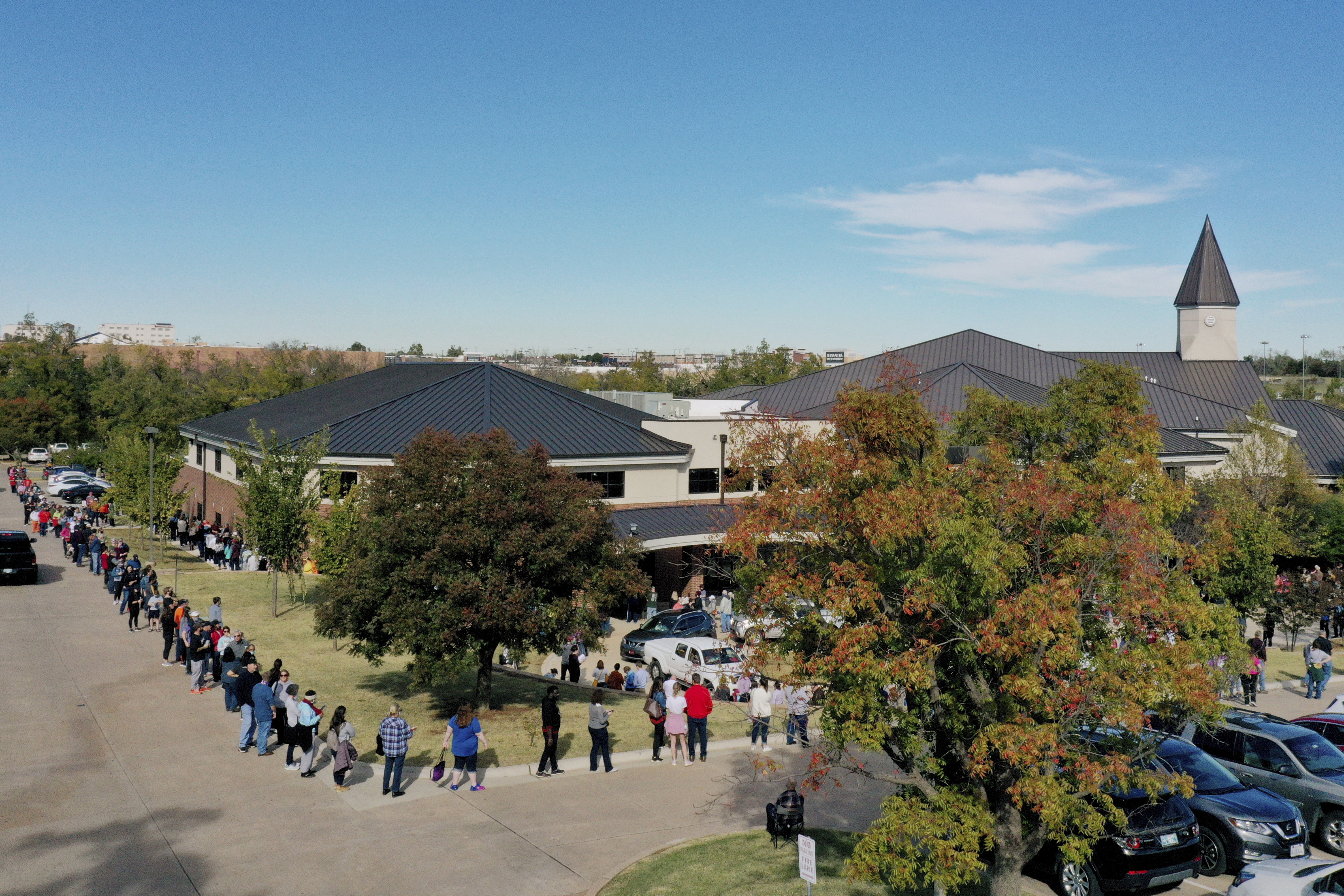 In this Friday, Oct. 30, 2020, file photo, a line for early voting at a polling place in Oklahoma County wraps around Edmond Church of Christ in Edmond, Okla.