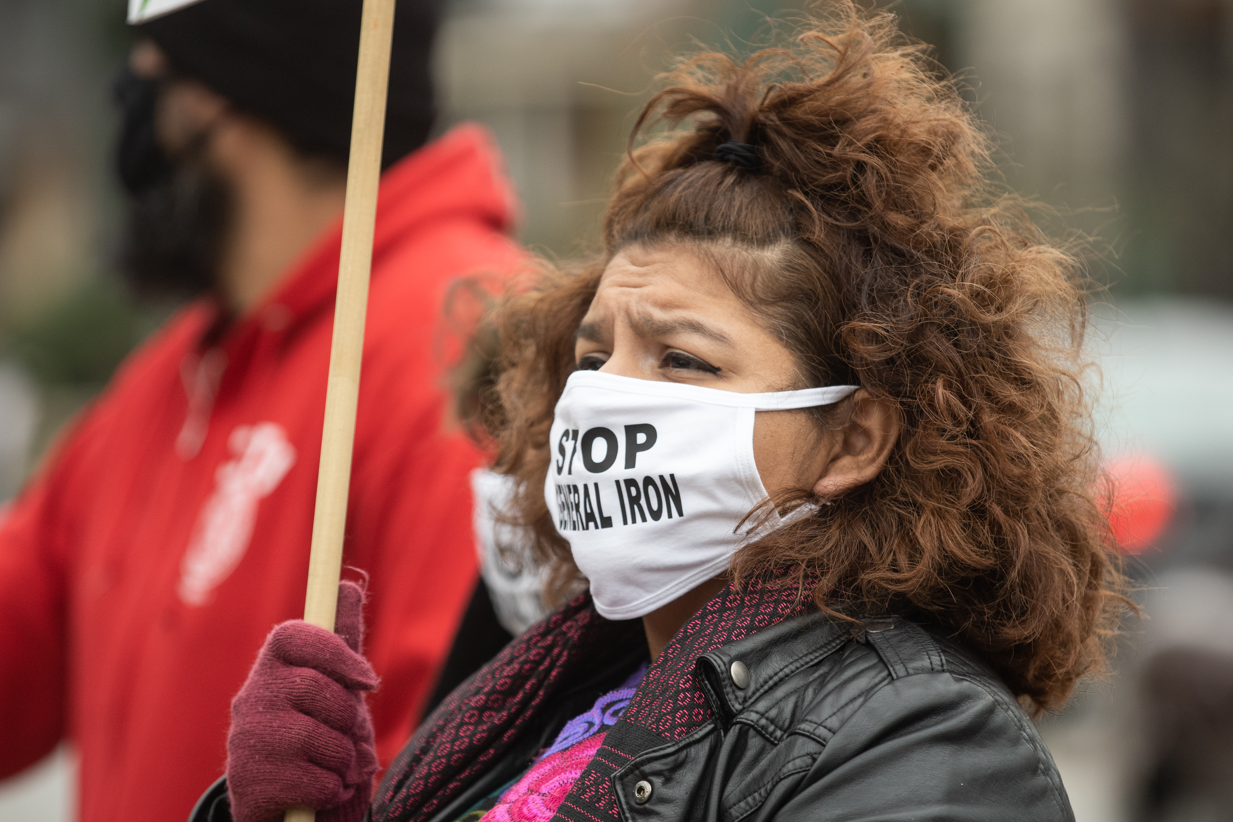 Nelly Martinez attends a November 2020 protest to demand Chicago Mayor Lori Lightfoot to deny the final permit that will allow General Iron to move from Lincoln Park, a mostly white neighborhood, to the Southeast Side, which has a mostly Latino population. | Pat Nabong/Sun-Times