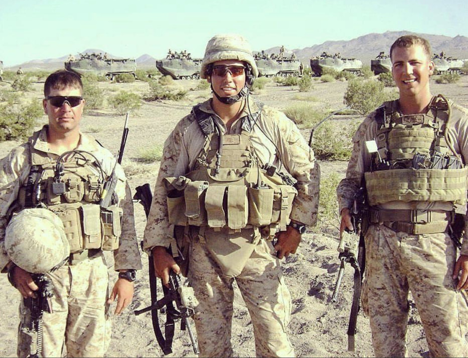 Marine Maj. Thomas Schueman (right), a Chicago native, in Afghanistan. The Marist High School grad is trying to get an interpreter who he says helped save him and others out of that country and, with his family, allowed to move to the United States. The interpreter says his life has been threatened by the Taliban. But his U.S. visa application is in limbo. At left is Lt. William Donnelly, a friend of Schueman who was killed in action. Center is First Lt. Cameron West.