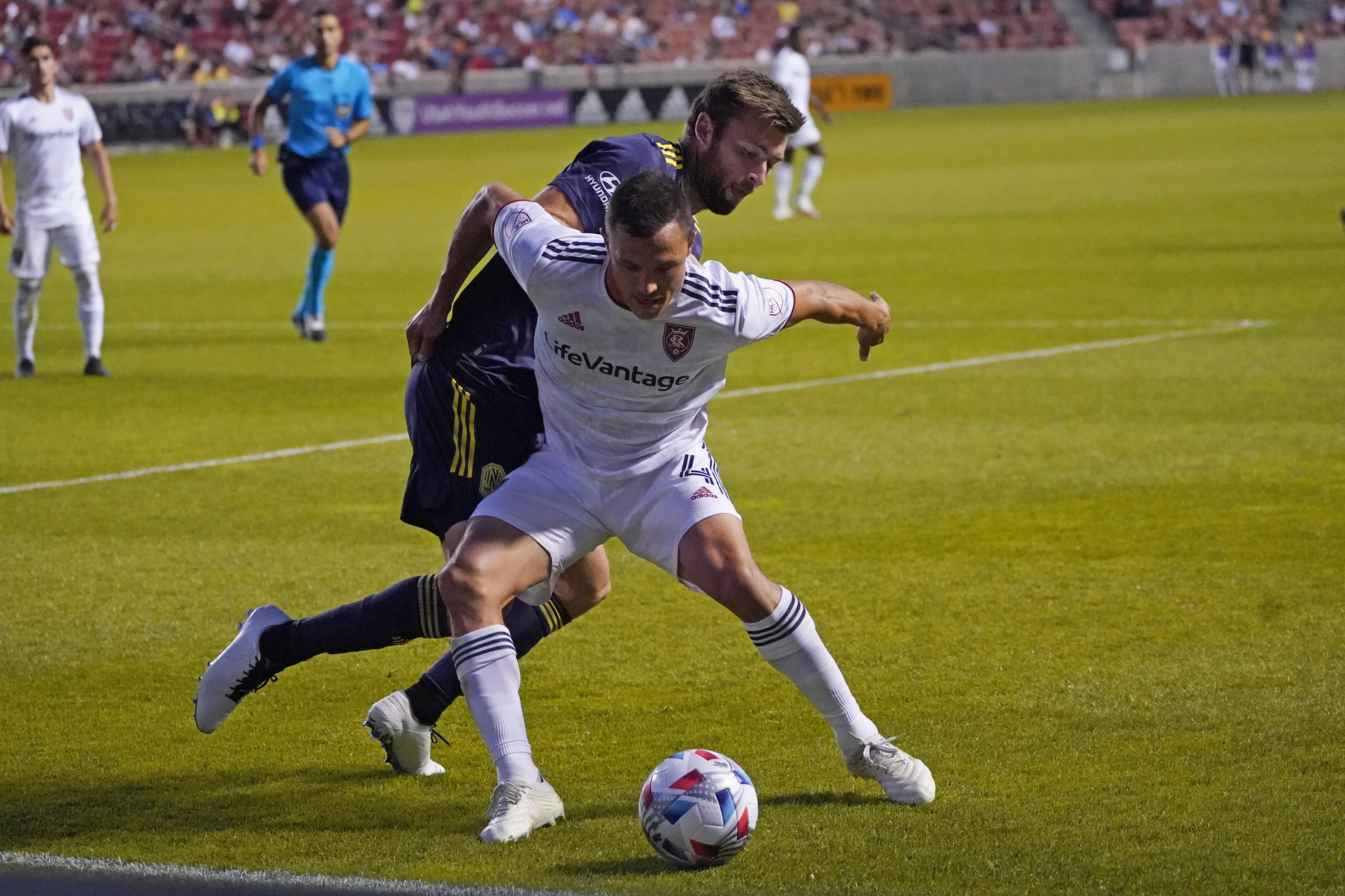 Real Salt Lake's Ddonny Toia and Nashville SC's Dave Romney battle for the ball during an MLS game on May 15, 2021.