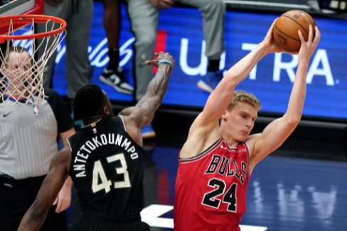 The Bulls' Lauri Markkanen grabs a rebound against the Bucks' Thanasis Antetokounmpo — Giannis' brother — during the first half Sunday at the United Center.