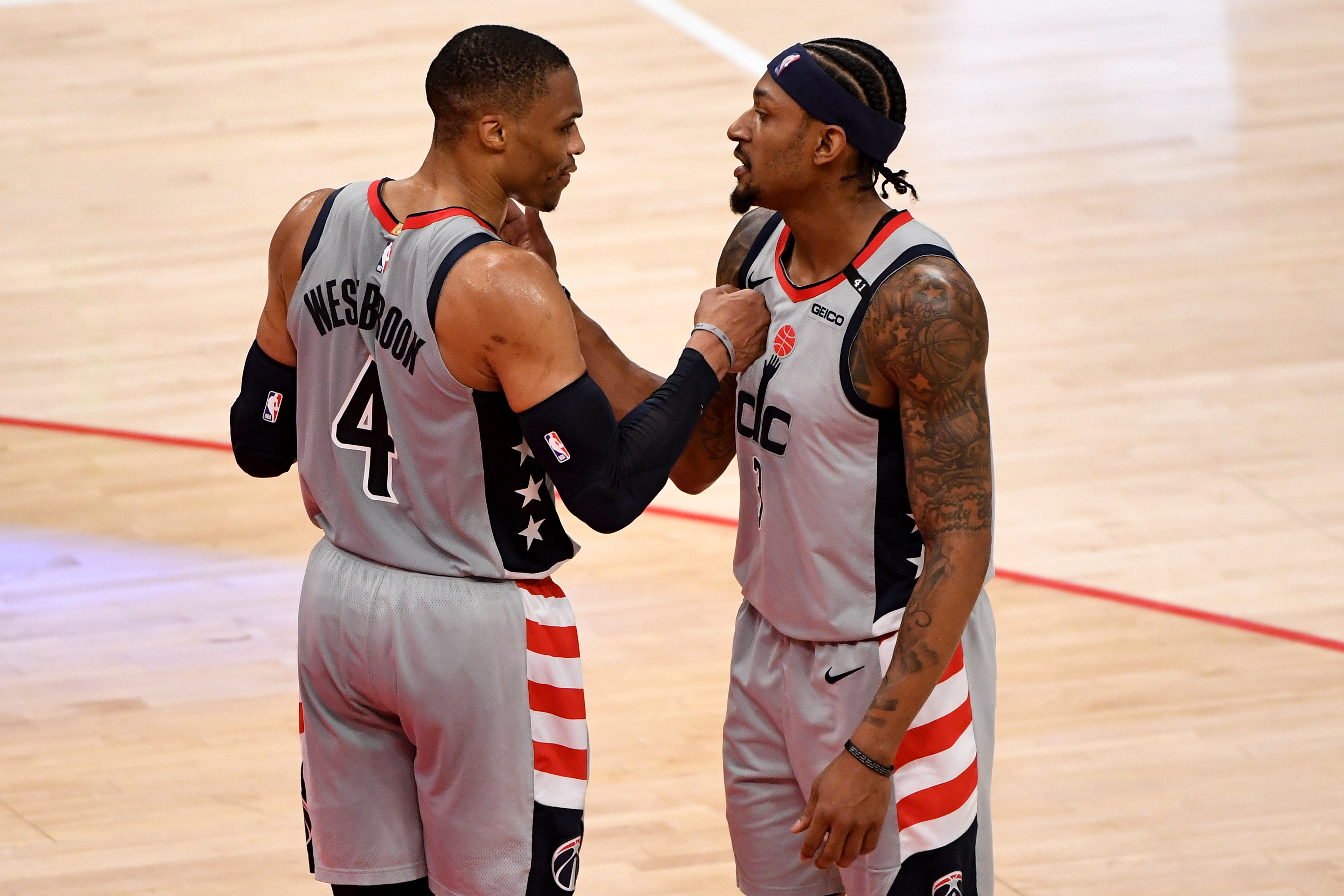 Russell Westbrook and Bradley Beal of the Washington Wizards celebrate after defeating the Charlotte Hornets at Capital One Arena on May 16, 2021 in Washington, DC.