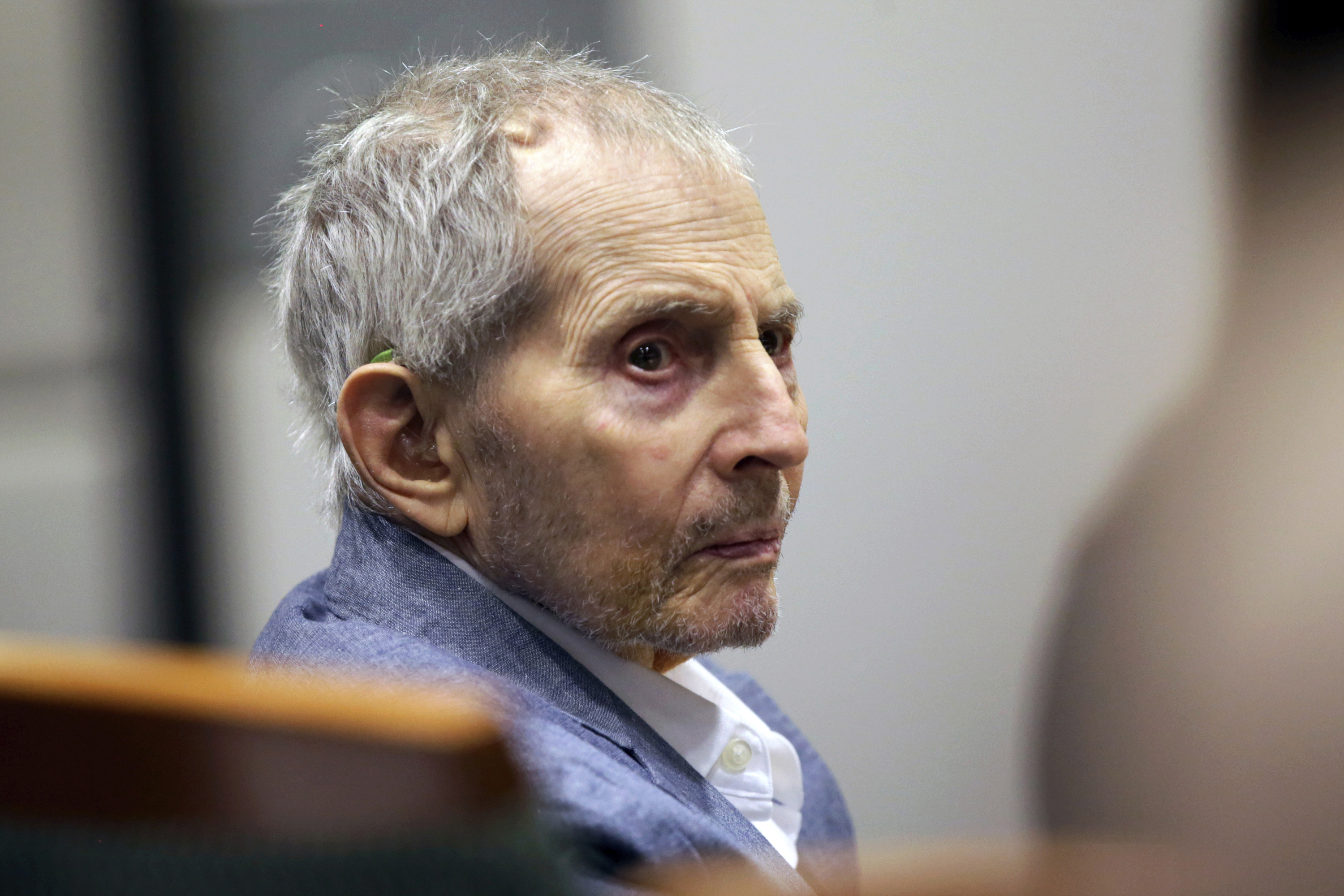 In this March 10, 2020, file photo, real estate heir Robert Durst looks over during his murder trial in Los Angeles.