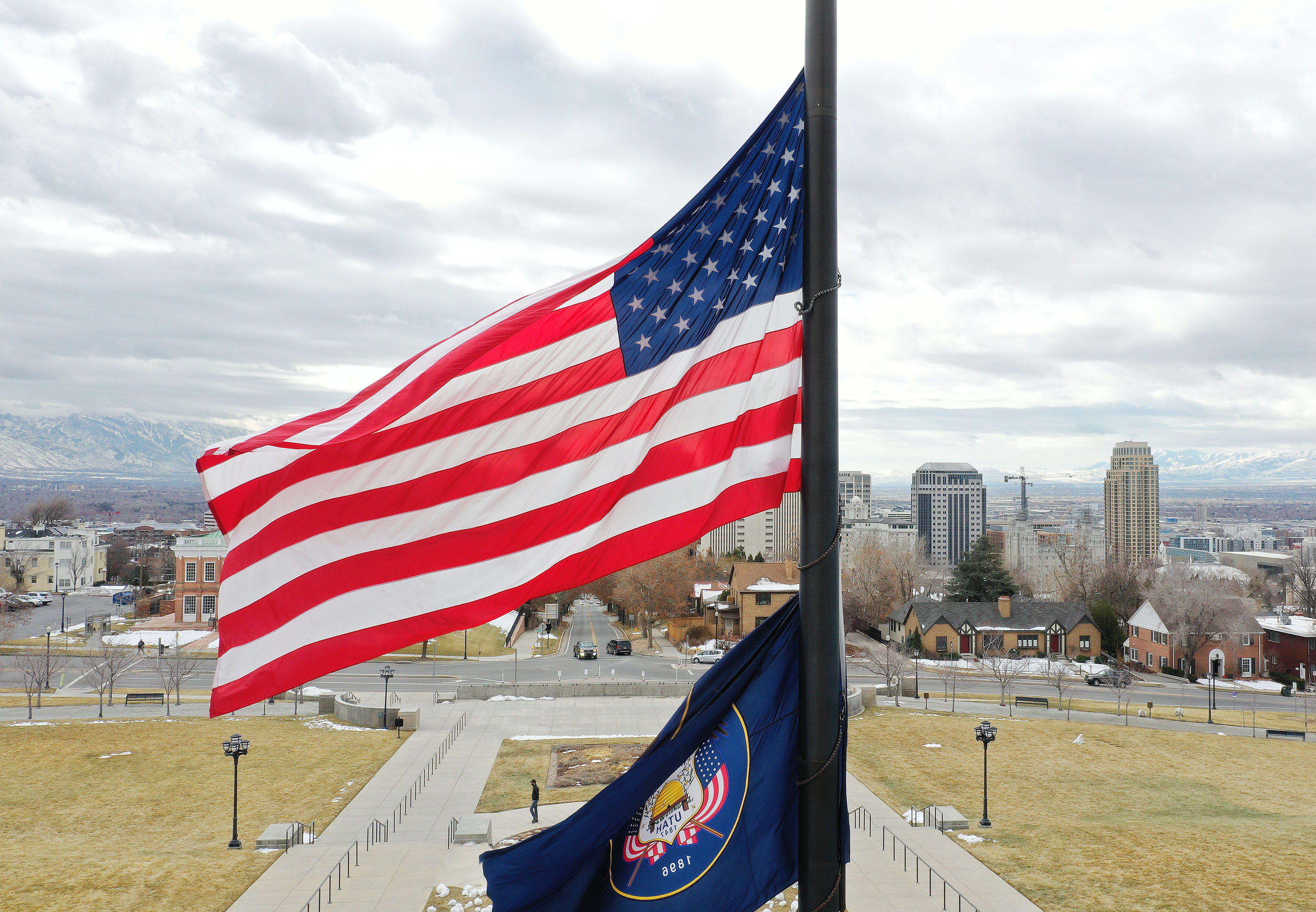 An American flag and Utah state flag fly at half-staff at the Capitol in Salt Lake City on Tuesday, Feb. 23, 2021.