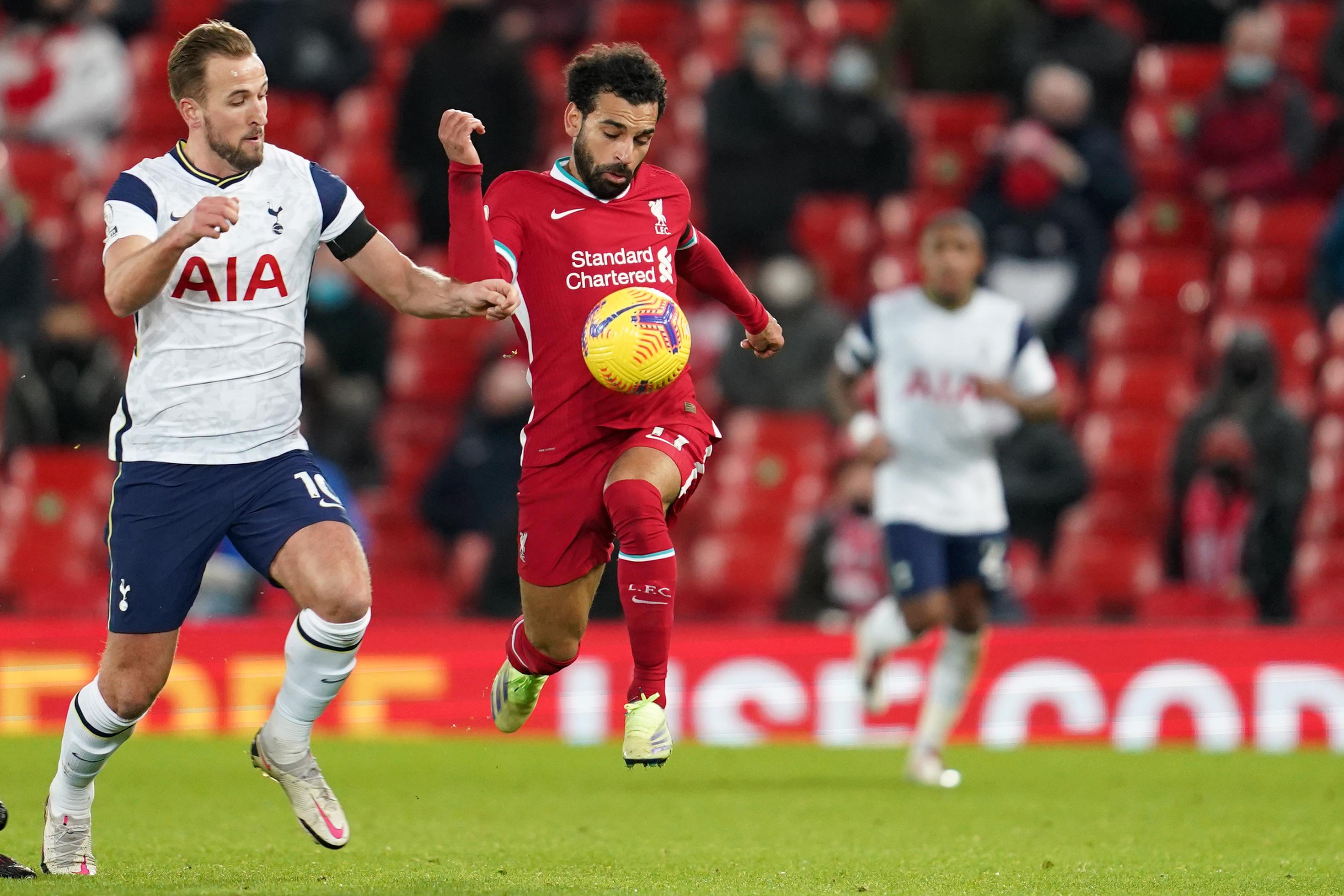 Harry Kane vies for the ball with Mohamed Salah - Liverpool vs Tottenham - Premier League