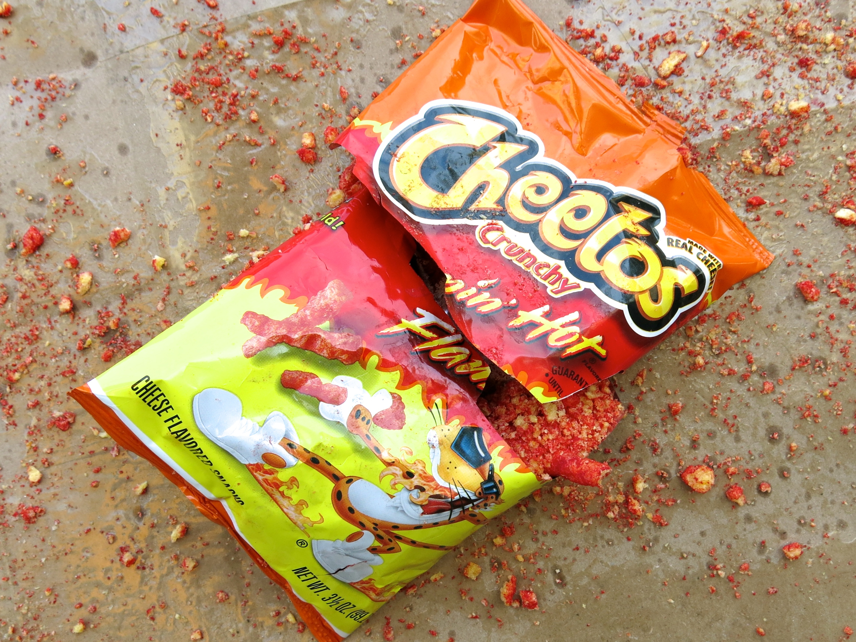 A bag of Flamin' Hot Cheetos on a brown background