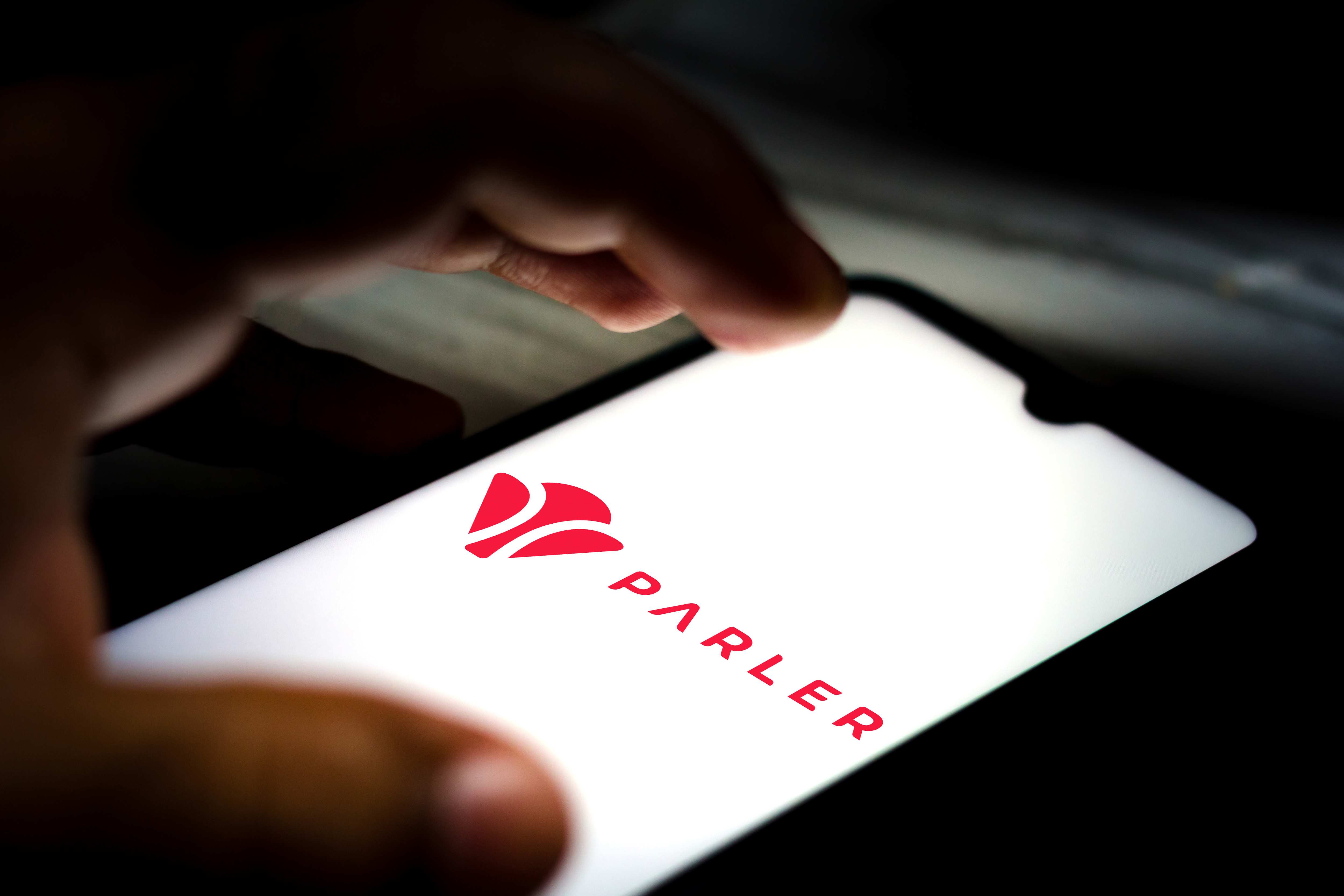 The Parler app on a phone screen.