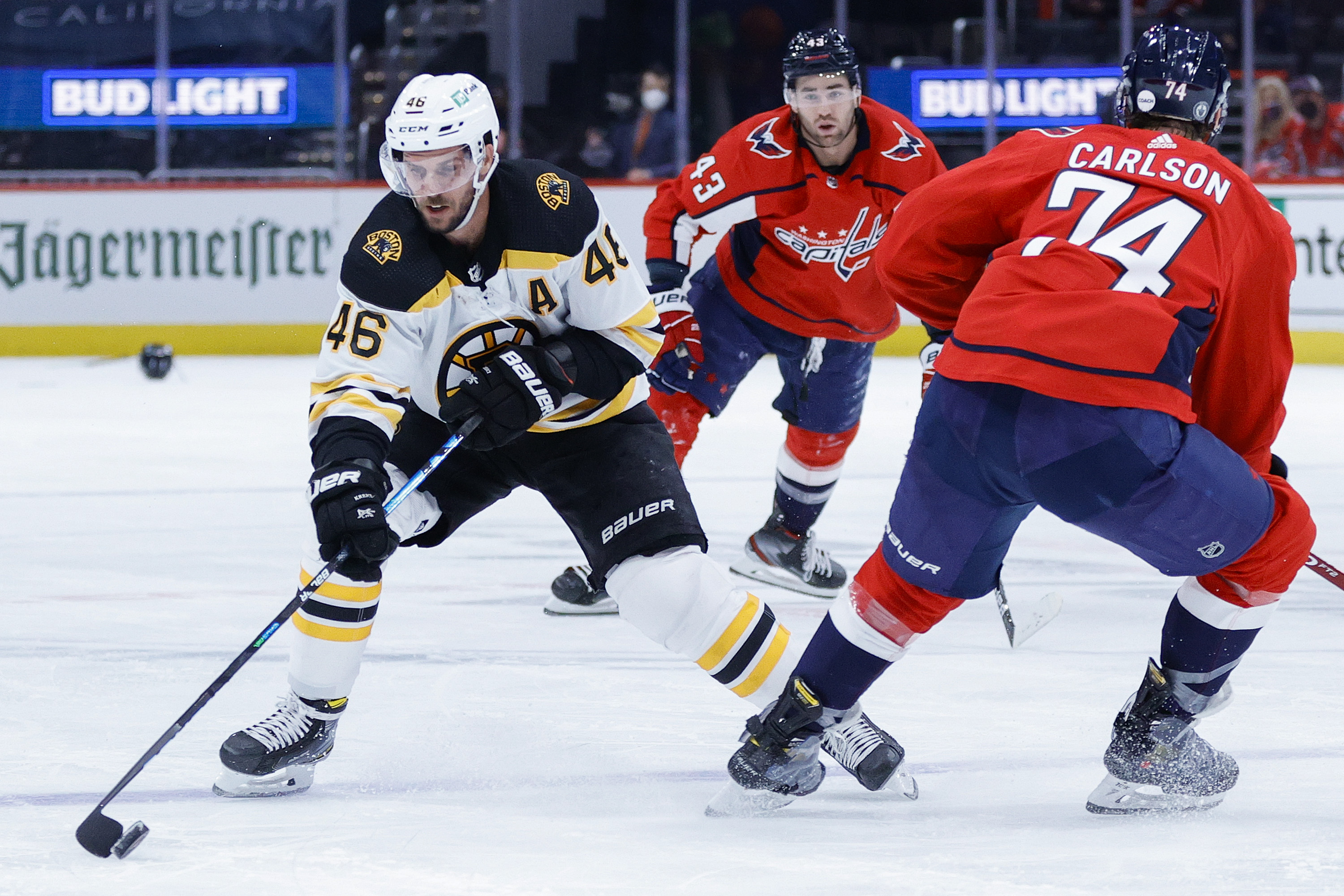 David Krejci #46 of the Boston Bruins skates past John Carlson #74 of the Washington Capitals during the third period during Game One of the First Round of the 2021 Stanley Cup Playoffs May 15, 2021 at Capital One Arena on May 15, 2021 in Washington, DC.