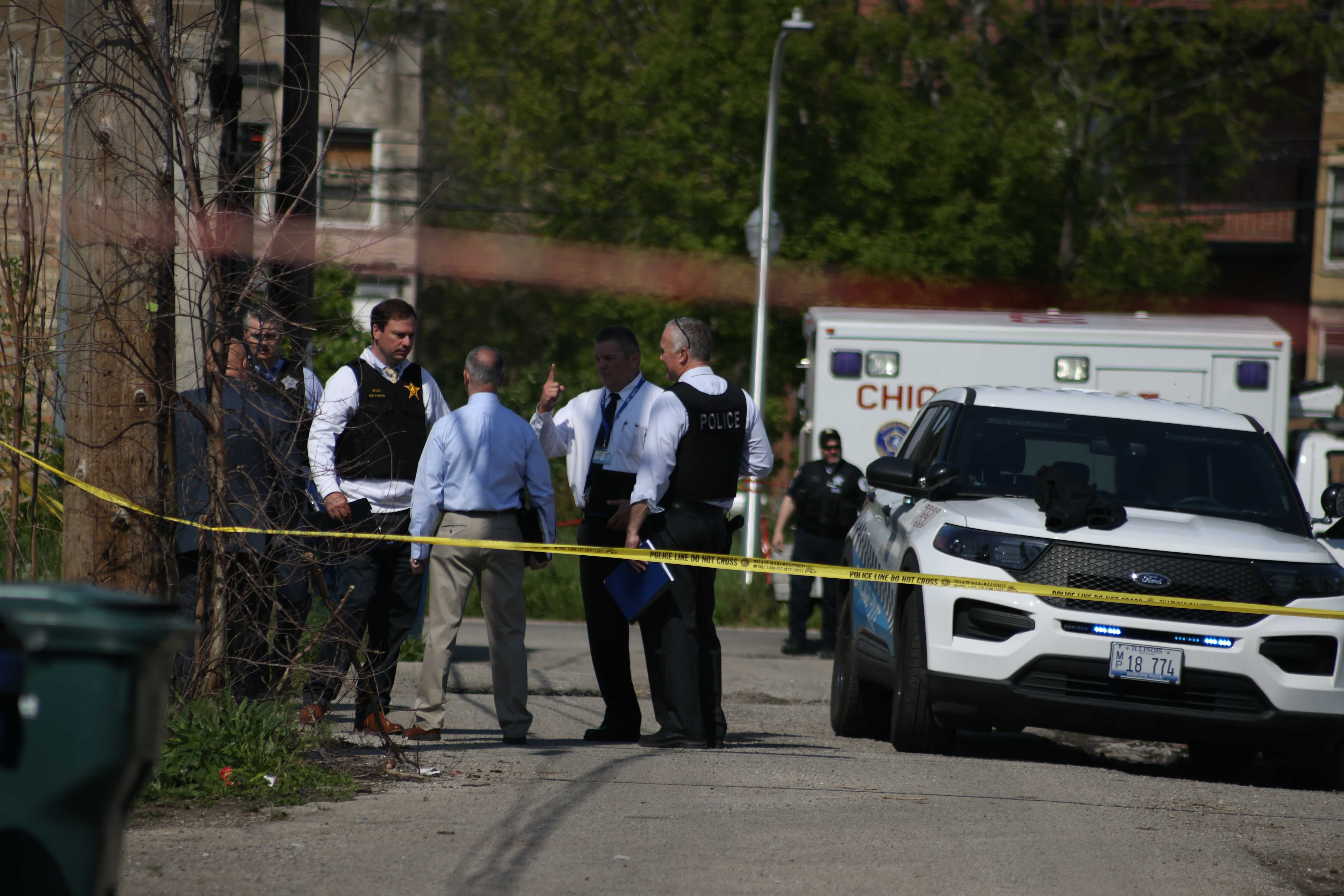 Chicago police investigate the scene where two officers were shot May 16, 2021, in Lawndale.