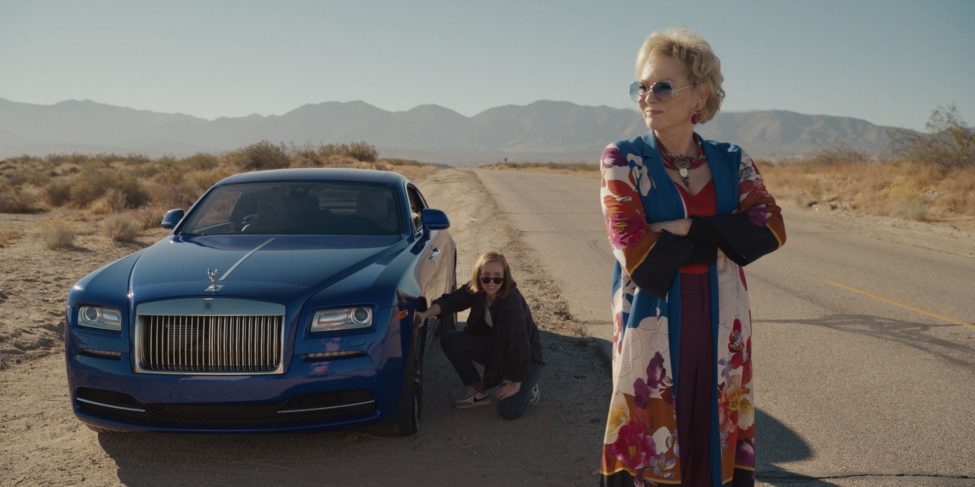 Deborah and Ava in the middle of the desert beside a car in the new series Hacks.