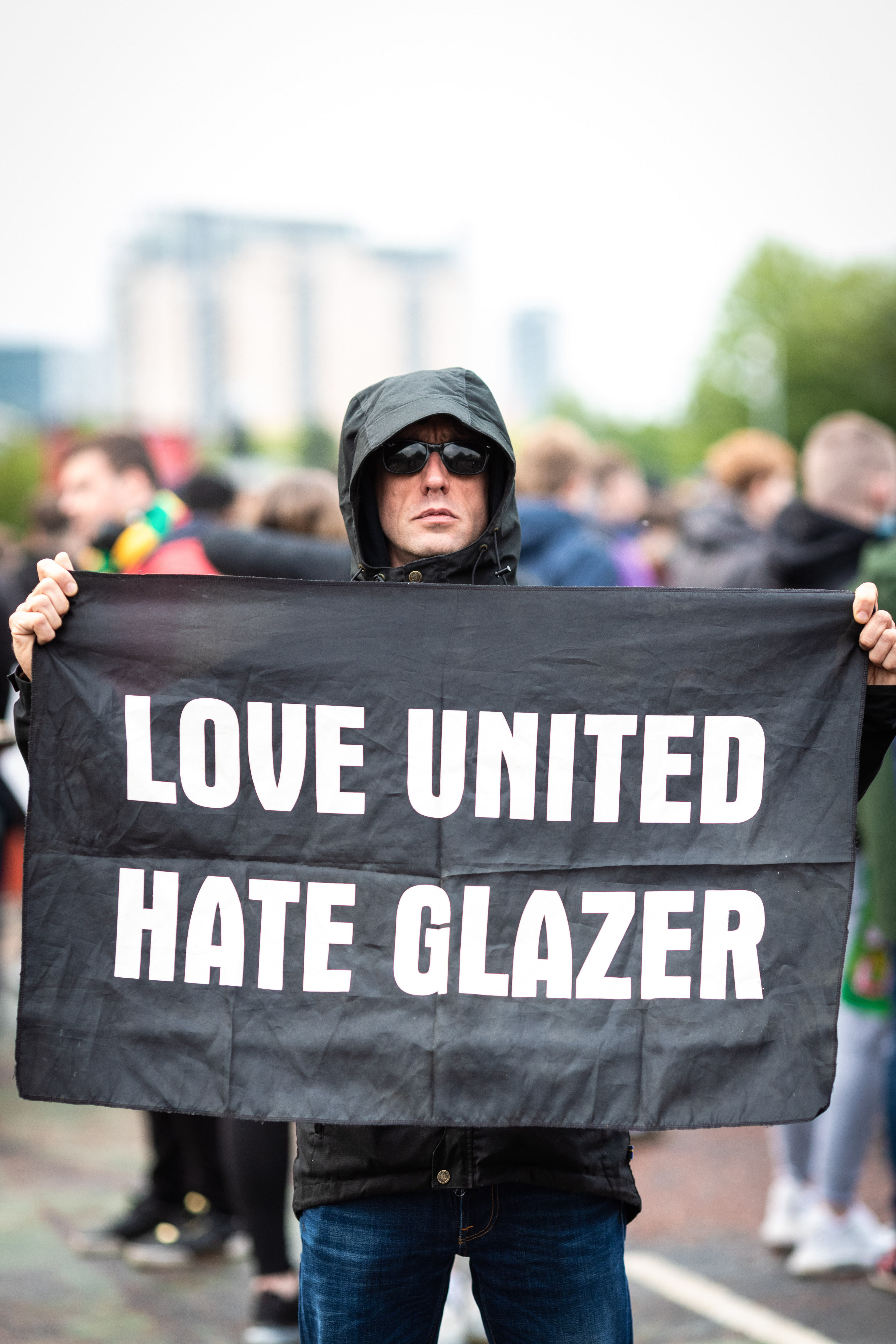 Manchester United fan holds a flag during the demonstration...