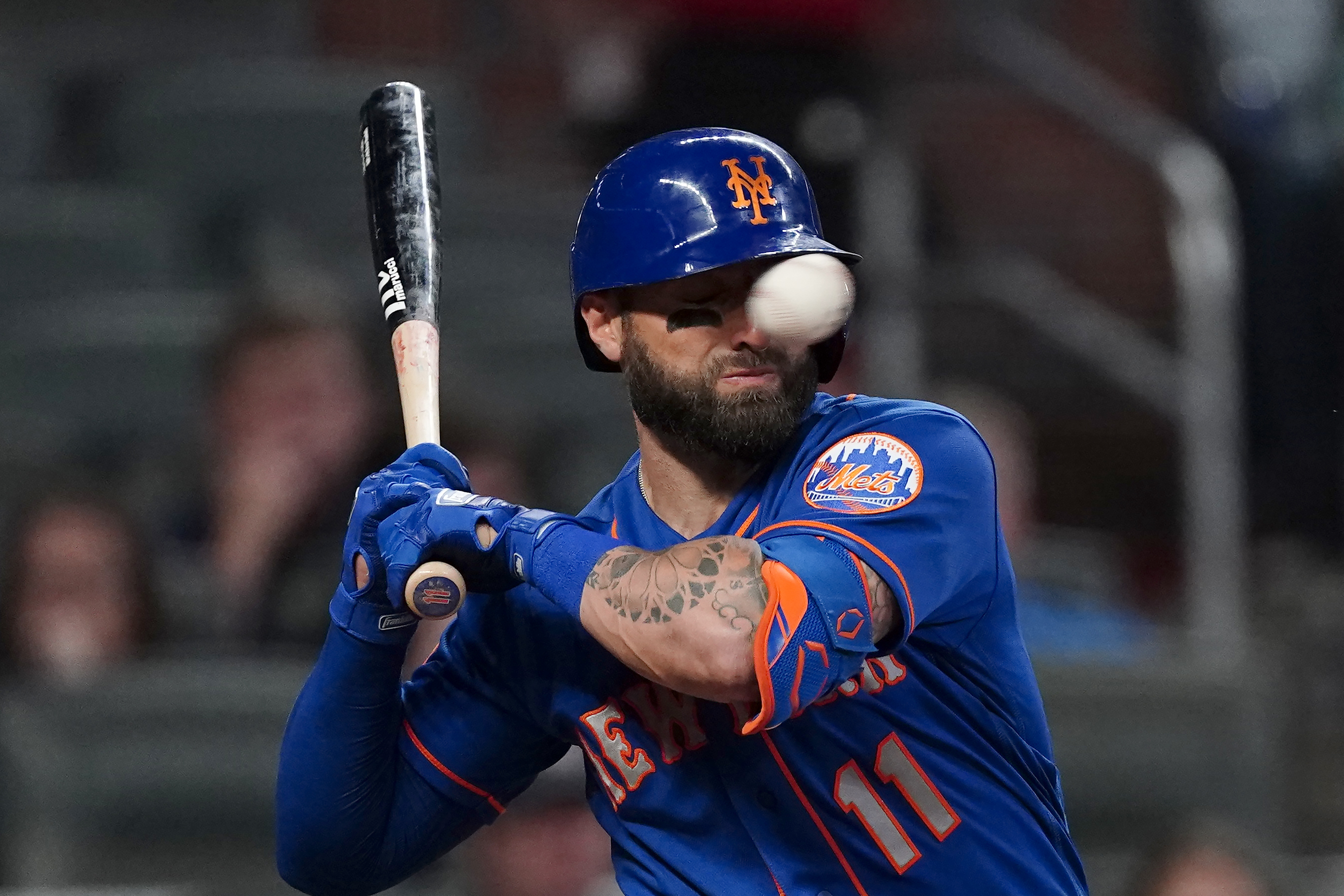 The Mets' Kevin Pillar is hit in the face with a pitch from Braves pitcher Jacob Webb in the seventh inning of Monday's game.