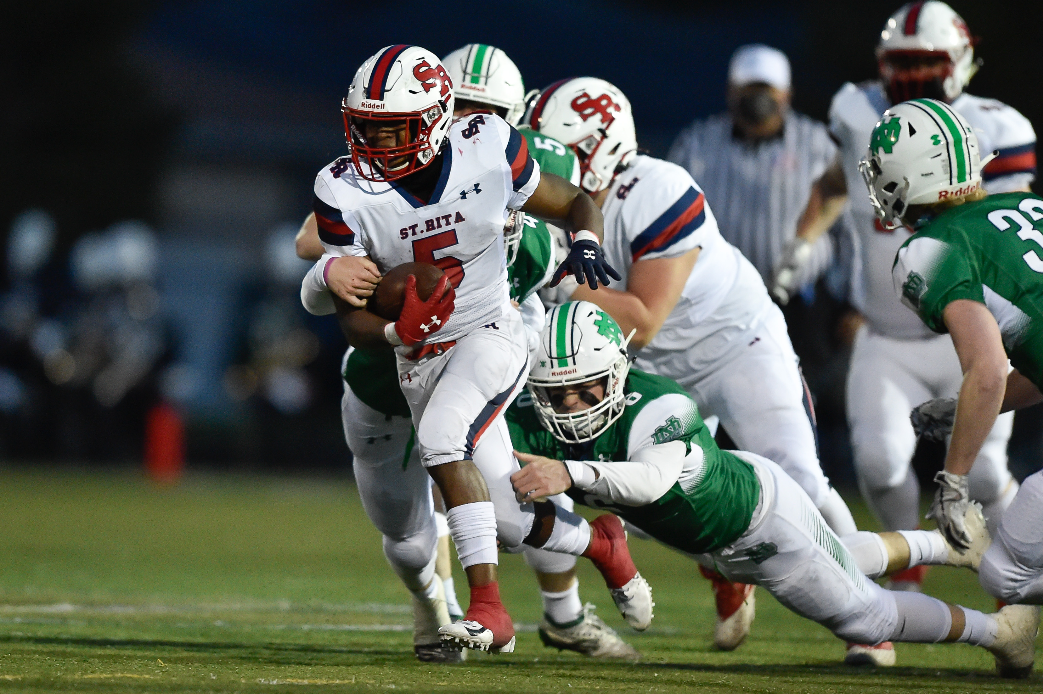 St. Rita's Kyle James (5) runs the ball past Notre Dame's defense.