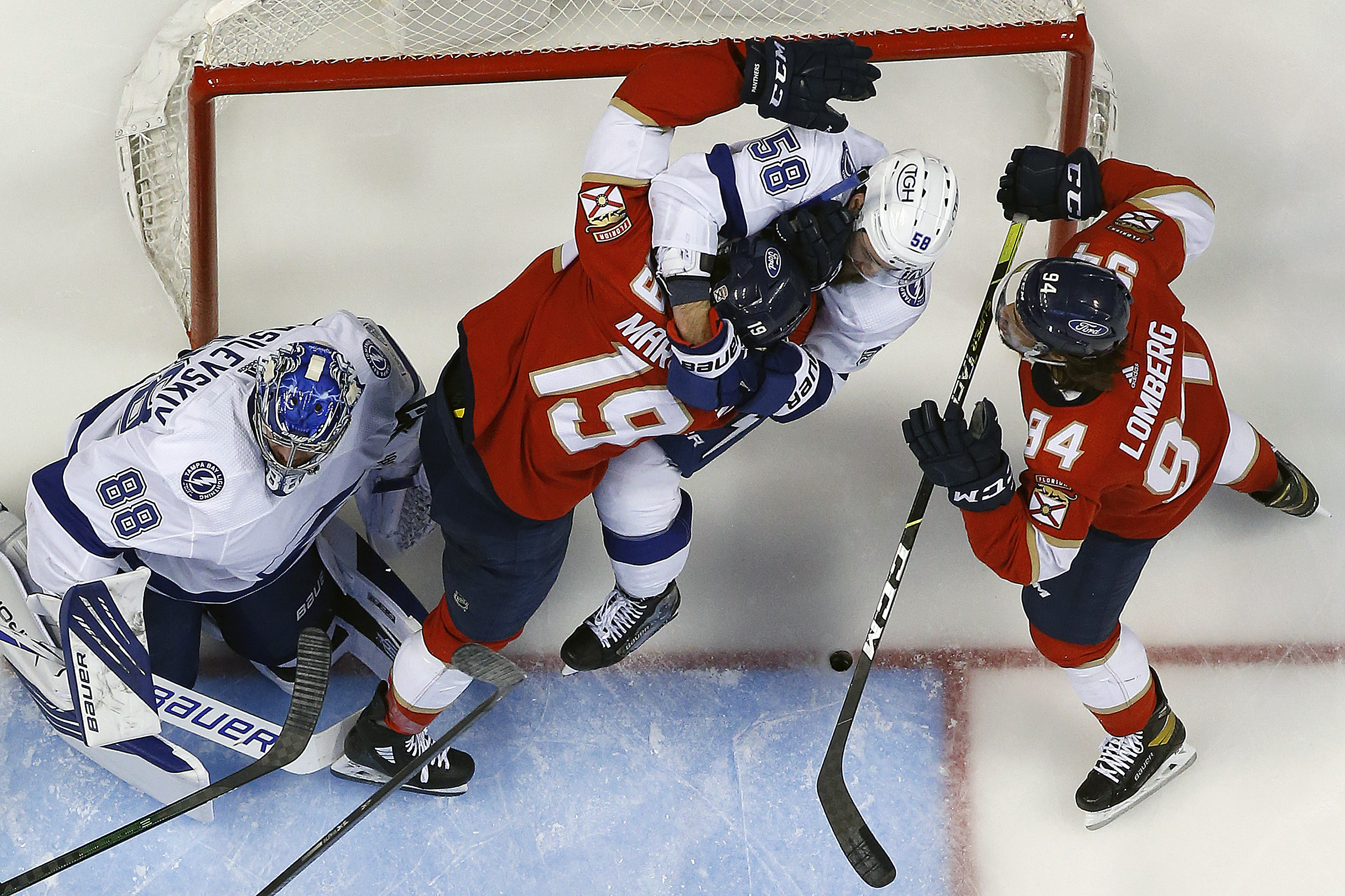 Goaltender Andrei Vasilevskly #88 and David Savard #58 of the Tampa Bay Lightning defend the net against Mason Marchment #19 of the Florida Panthers in Game One of the First Round of the 2021 Stanley Cup Playoffs at the BB&T Center on May 16, 2021 in Sunrise, Florida.