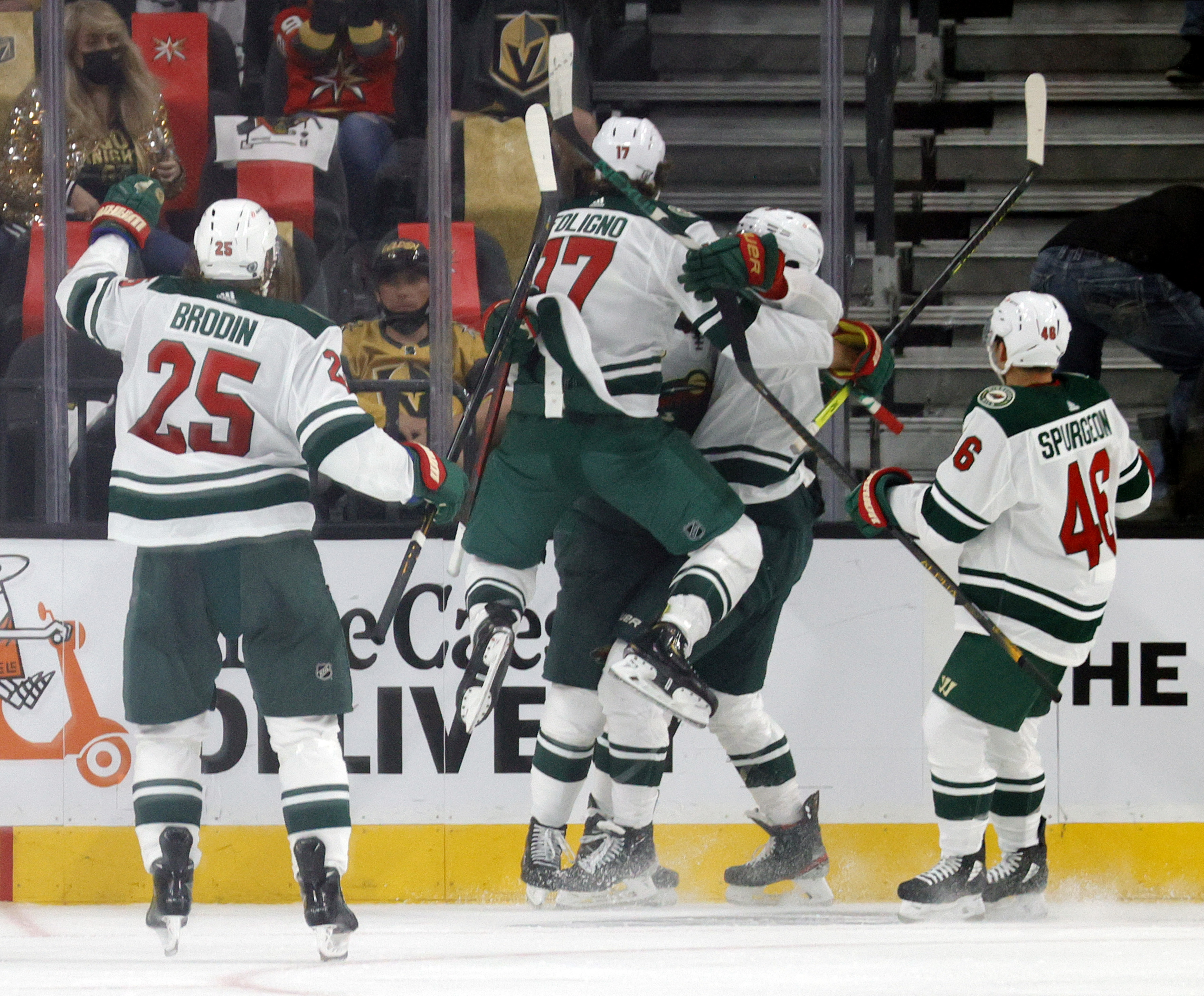 Jonas Brodin #25, Marcus Foligno #17, Joel Eriksson Ek #14, Jordan Greenway #18 and Jared Spurgeon #46 of the Minnesota Wild celebrate after Eriksson Ek scored an overtime goal against the Vegas Golden Knights to win Game One of the First Round of the 2021 Stanley Cup Playoffs 1-0 at T-Mobile Arena on May 16, 2021 in Las Vegas, Nevada.