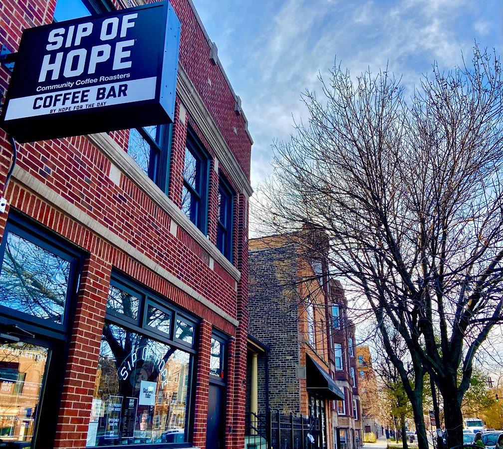 A brick facade of a coffeshop.