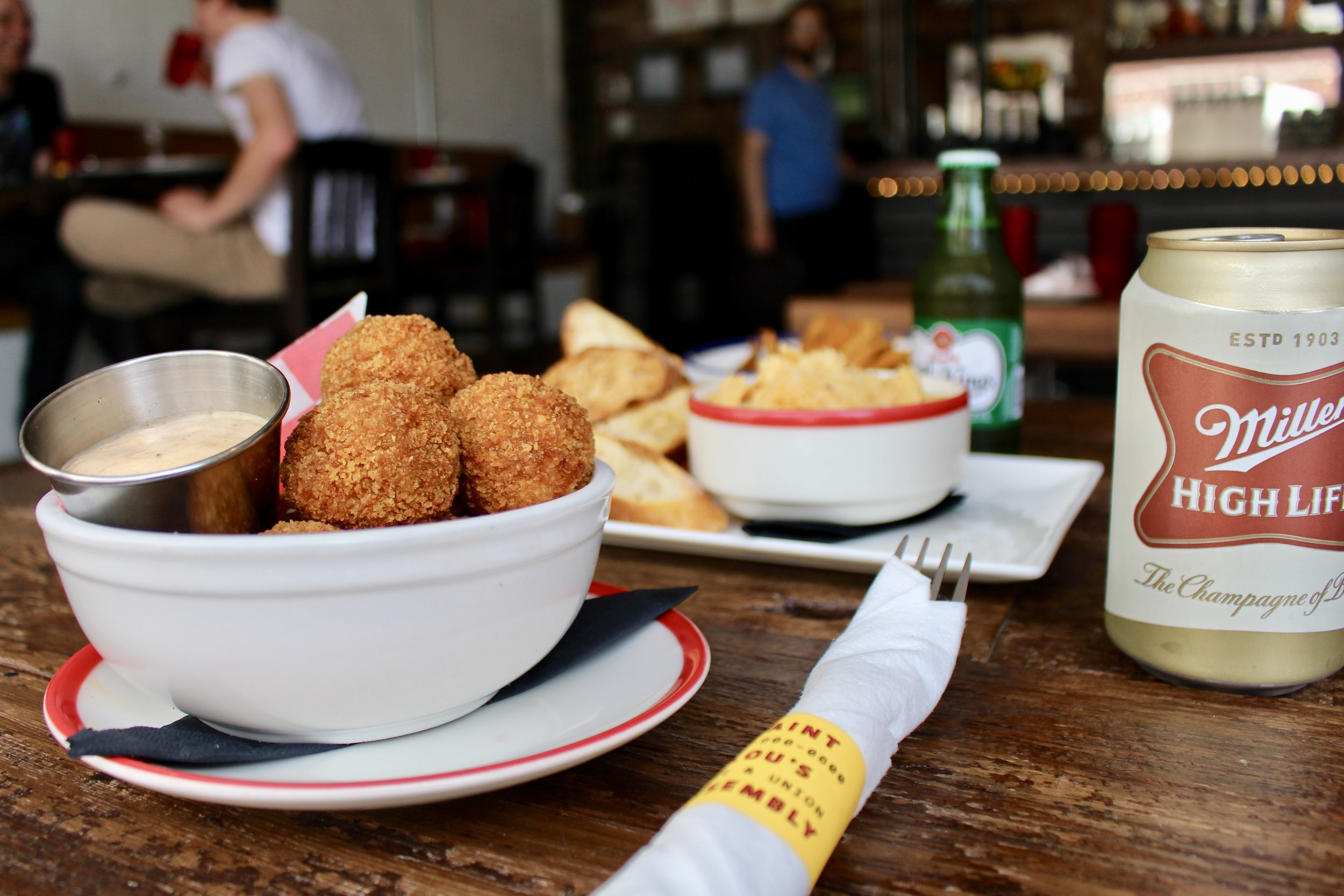 Lou's Backyard features hushpuppies with schmaltzy Tabasco sauce.