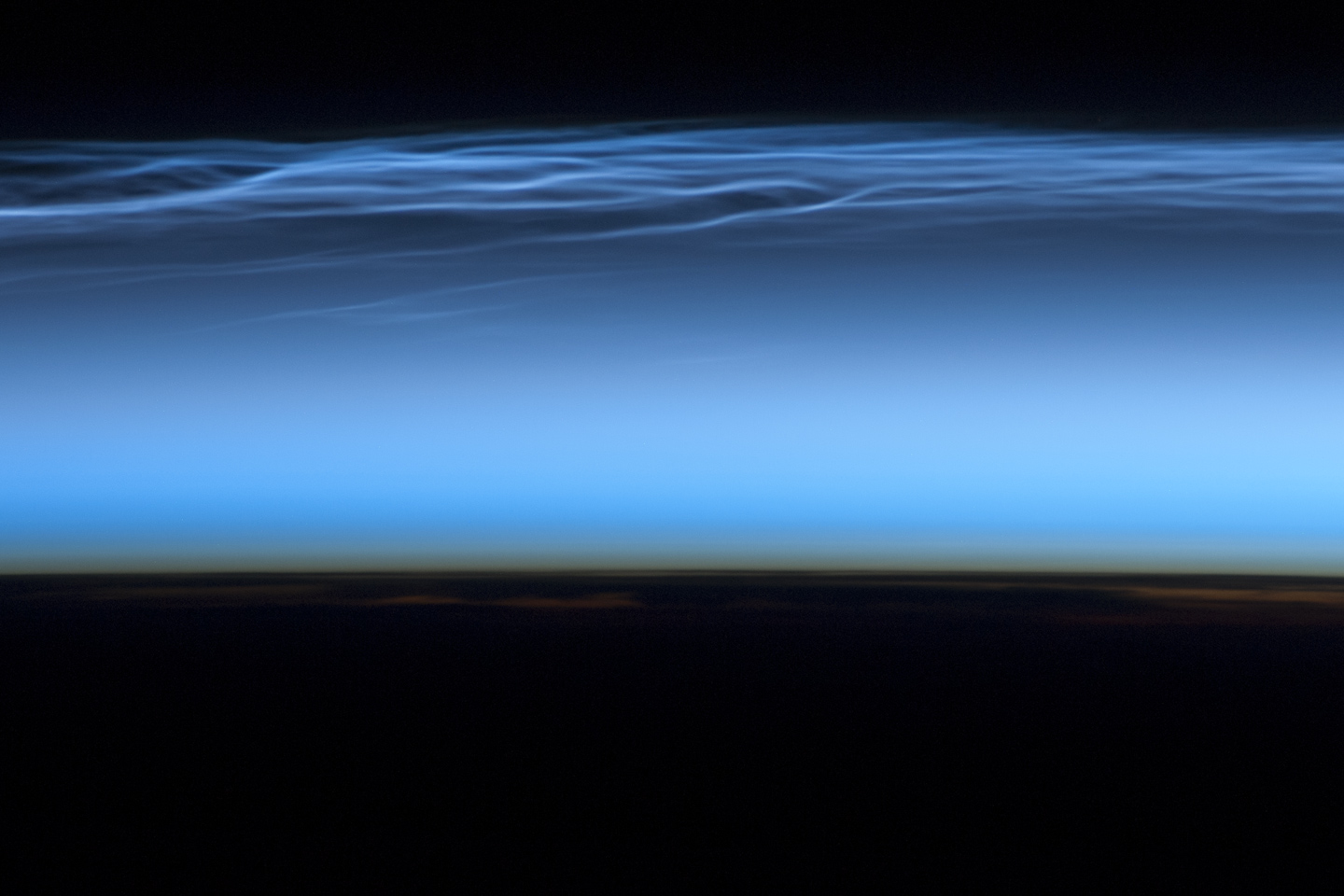 Photo of noctilucent clouds