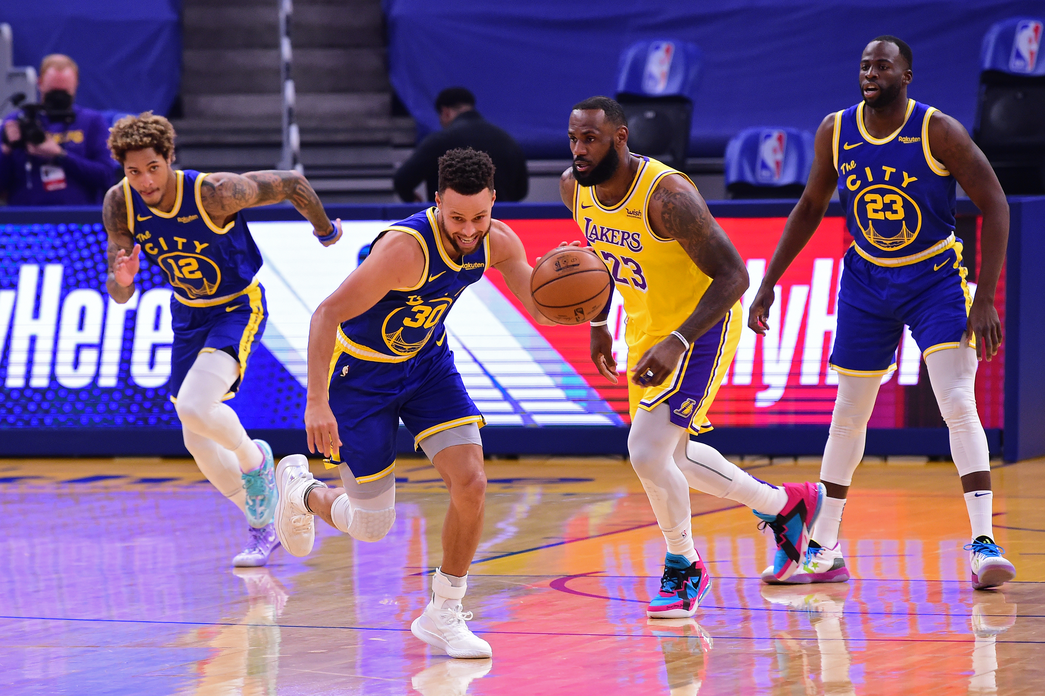 Stephen Curry of the Golden State Warriors dribbles down court during the game against the Los Angeles Lakers on March 15, 2021 at Chase Center in San Francisco, California.