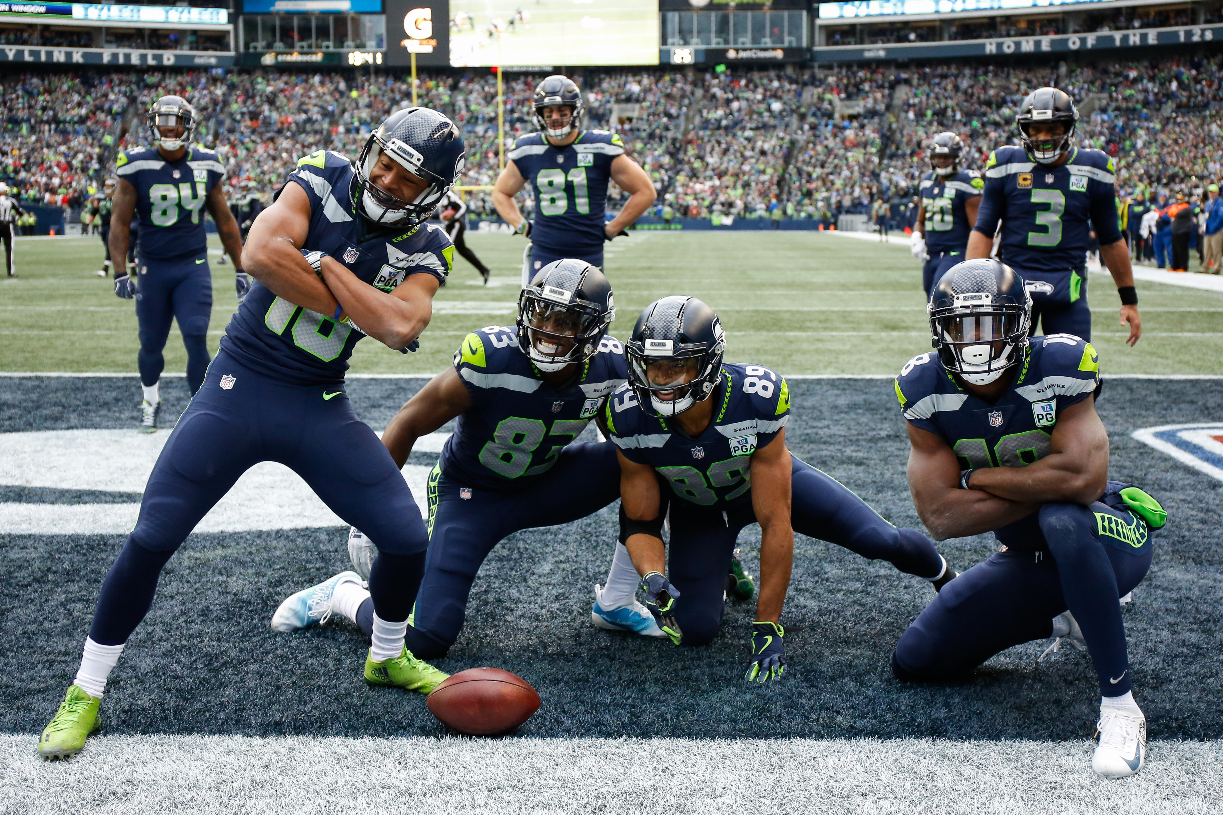 Tyler Lockett #16 of the Seattle Seahawks celebrates a second quarter touchdown with teammates in the game against the San Francisco 49ers at CenturyLink Field on December 2, 2018 in Seattle, Washington.