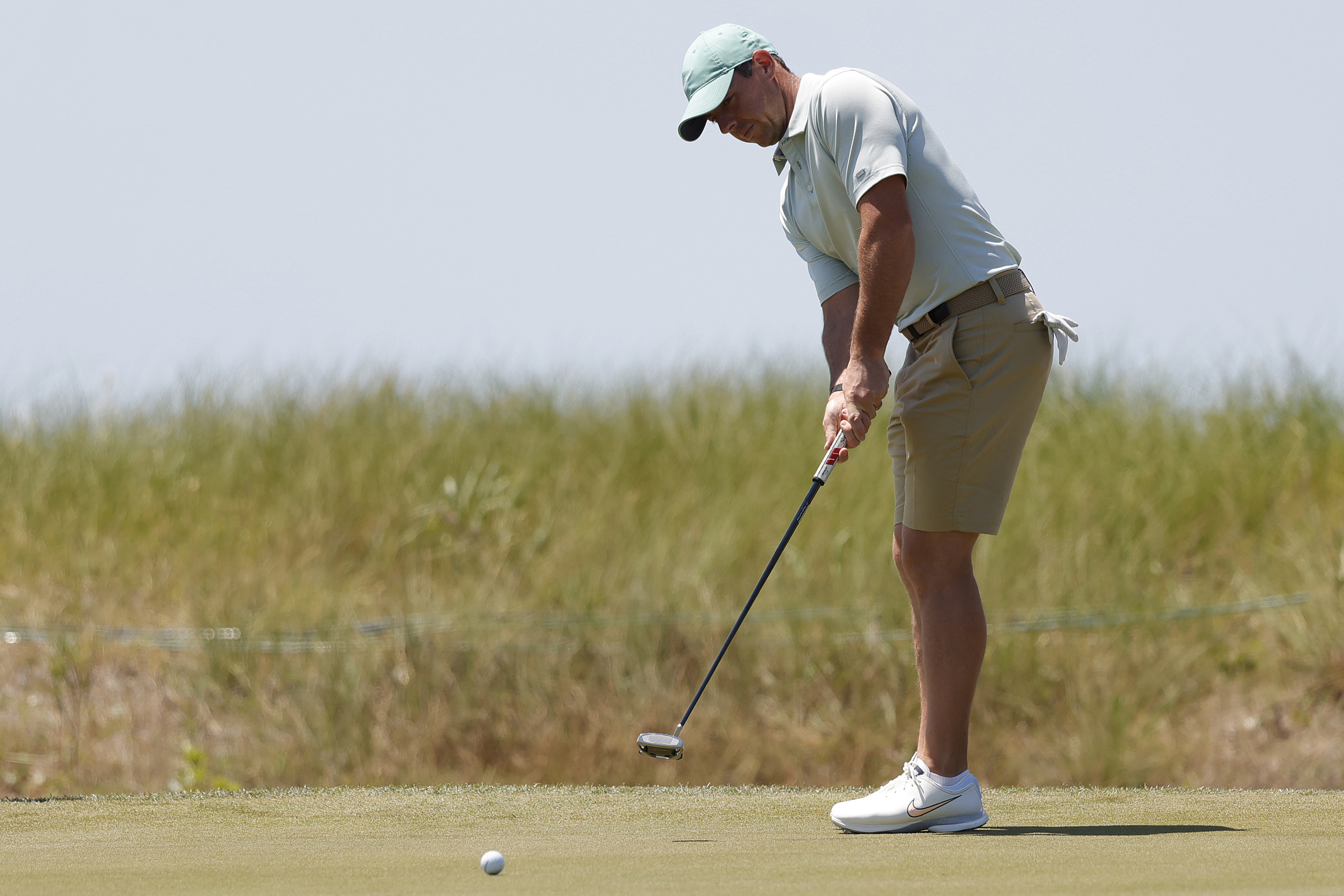 Rory McIlroy putts on the seventh hole during a practice round for the PGA Championship golf tournament at Ocean Course at Kiawah Island Resort.