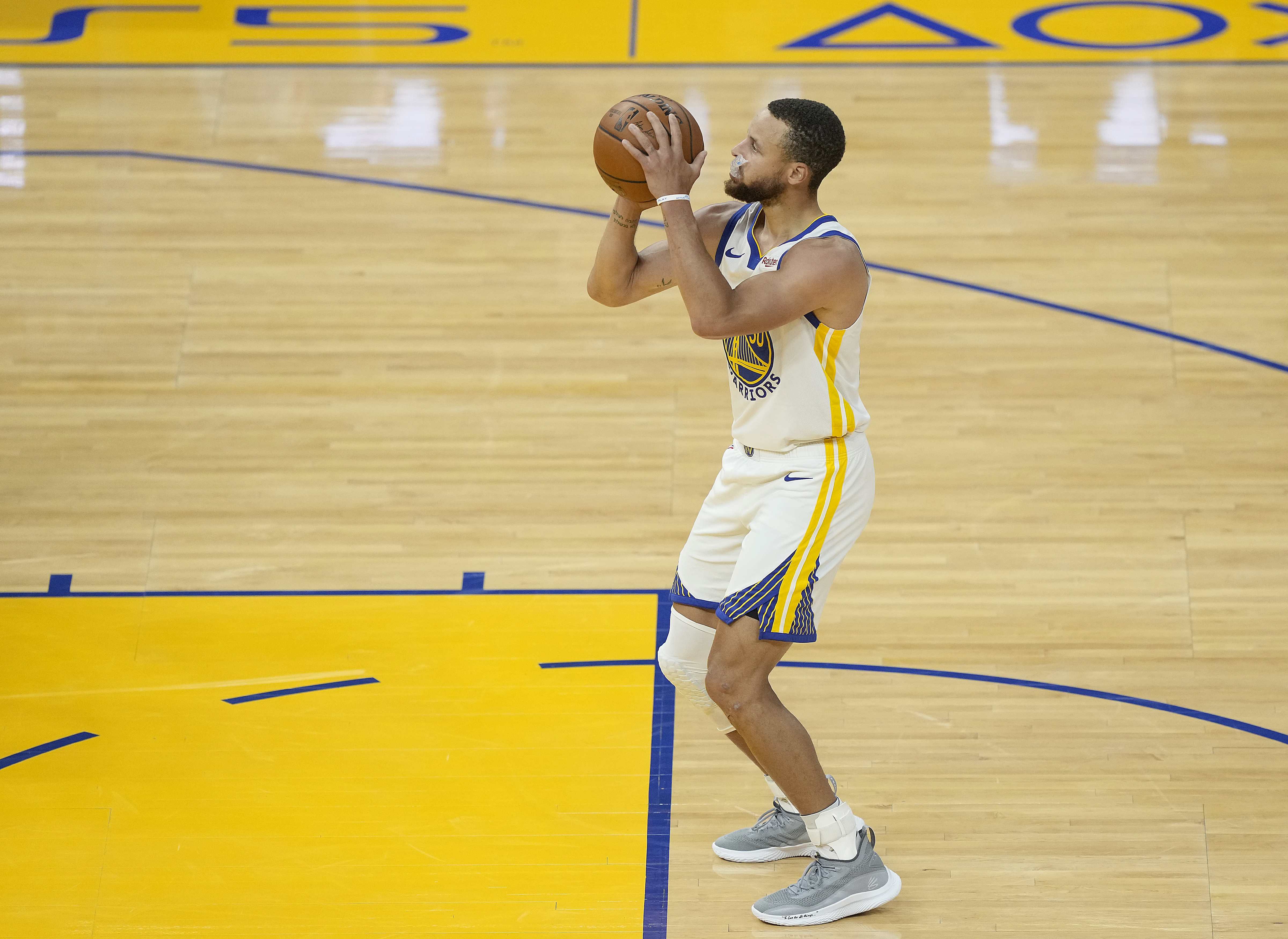 Stephen Curry #30 of the Golden State Warriors stands at the line to shoot a foul shot against the Memphis Grizzlies during the second half of an NBA basketball game at Chase Center on May 16, 2021 in San Francisco, California.. ,