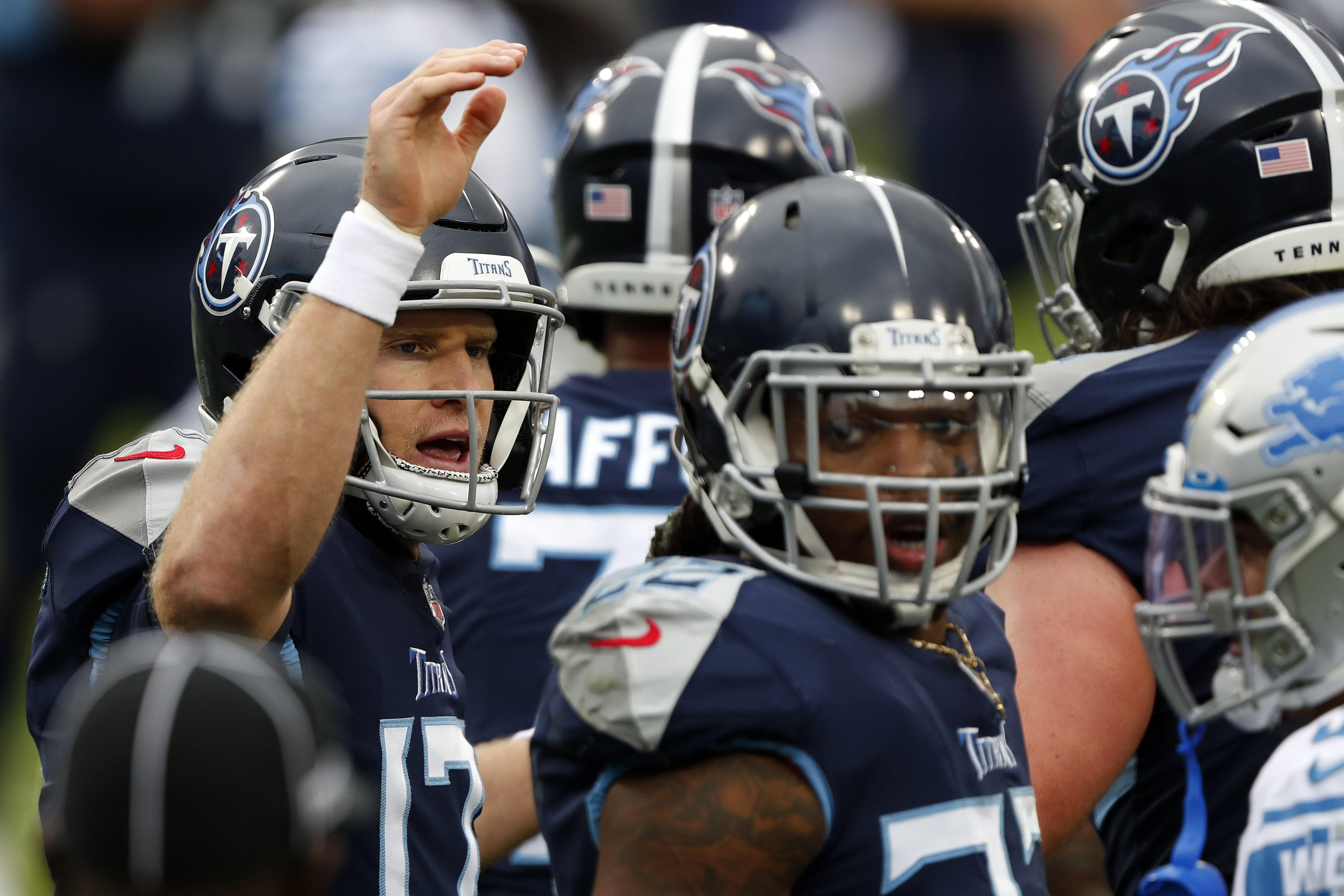 Quarterback Ryan Tannehill #17 and running back Derrick Henry #22 of the Tennessee Titans Detroit Lions huddle during the second quarter of the game at Nissan Stadium on December 20, 2020 in Nashville, Tennessee.