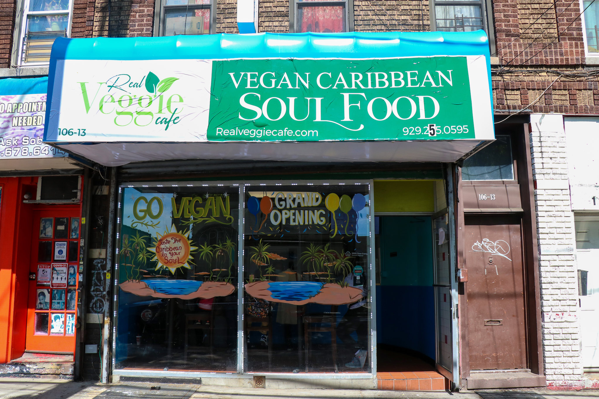 A green awning advertises vegan Caribbean soul food at the newly opened Real Veggie Cafe.