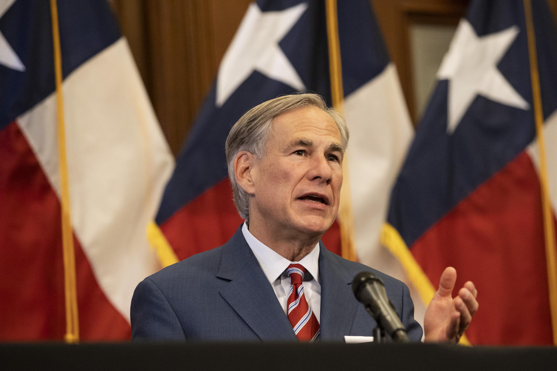 Texas Gov. Greg Abbott speaks in front of an American flag.