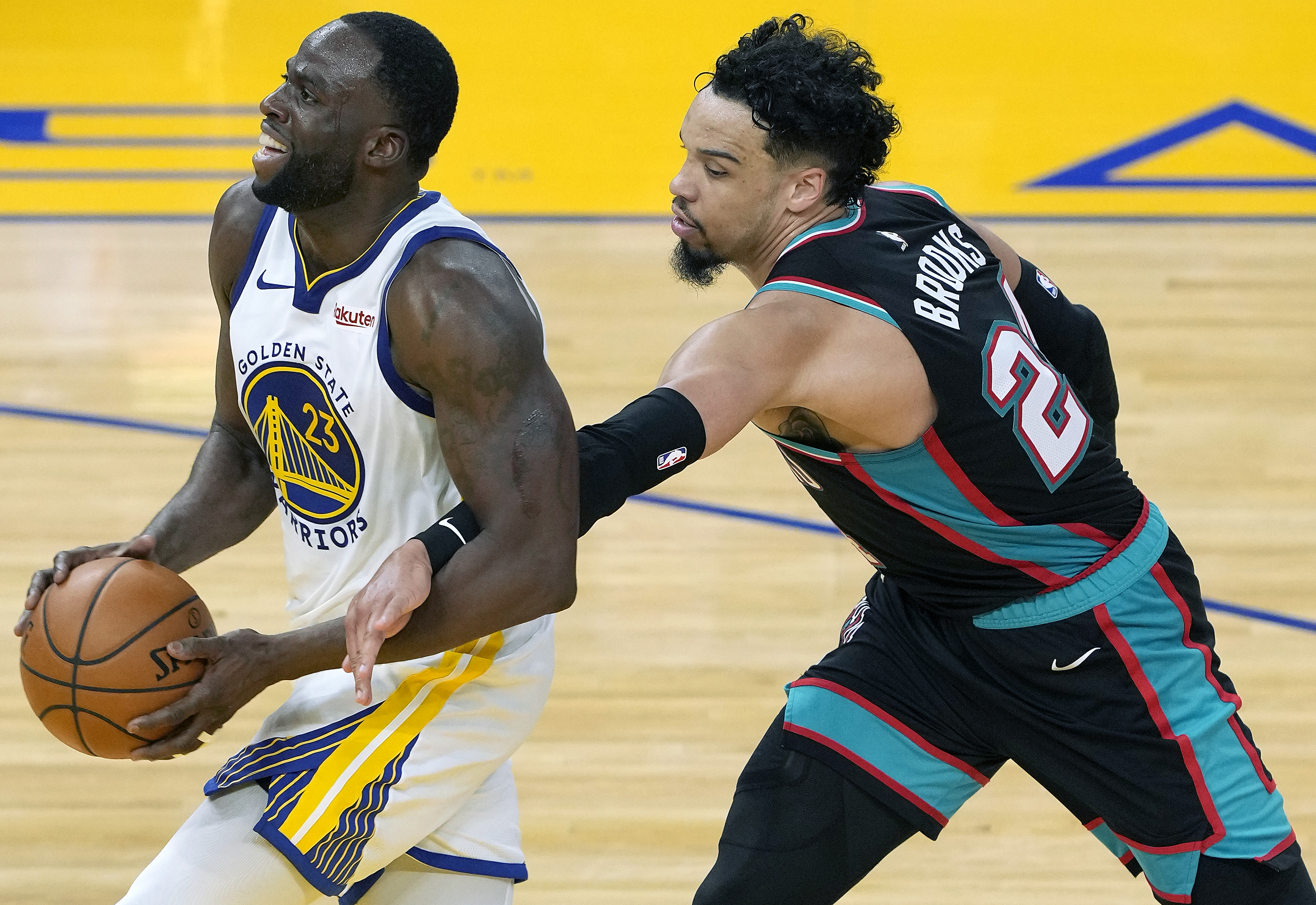 Draymond Green of the Golden State Warriors driving to the basket gets fouled by Dillon Brooks of the Memphis Grizzlies during the second half of an NBA basketball game at Chase Center on May 16, 2021 in San Francisco, California.