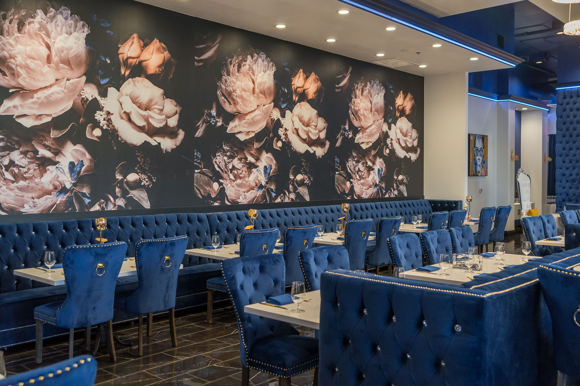 The plush blue-tinged dining room at Henderson's Blume Kitchen & Cocktails