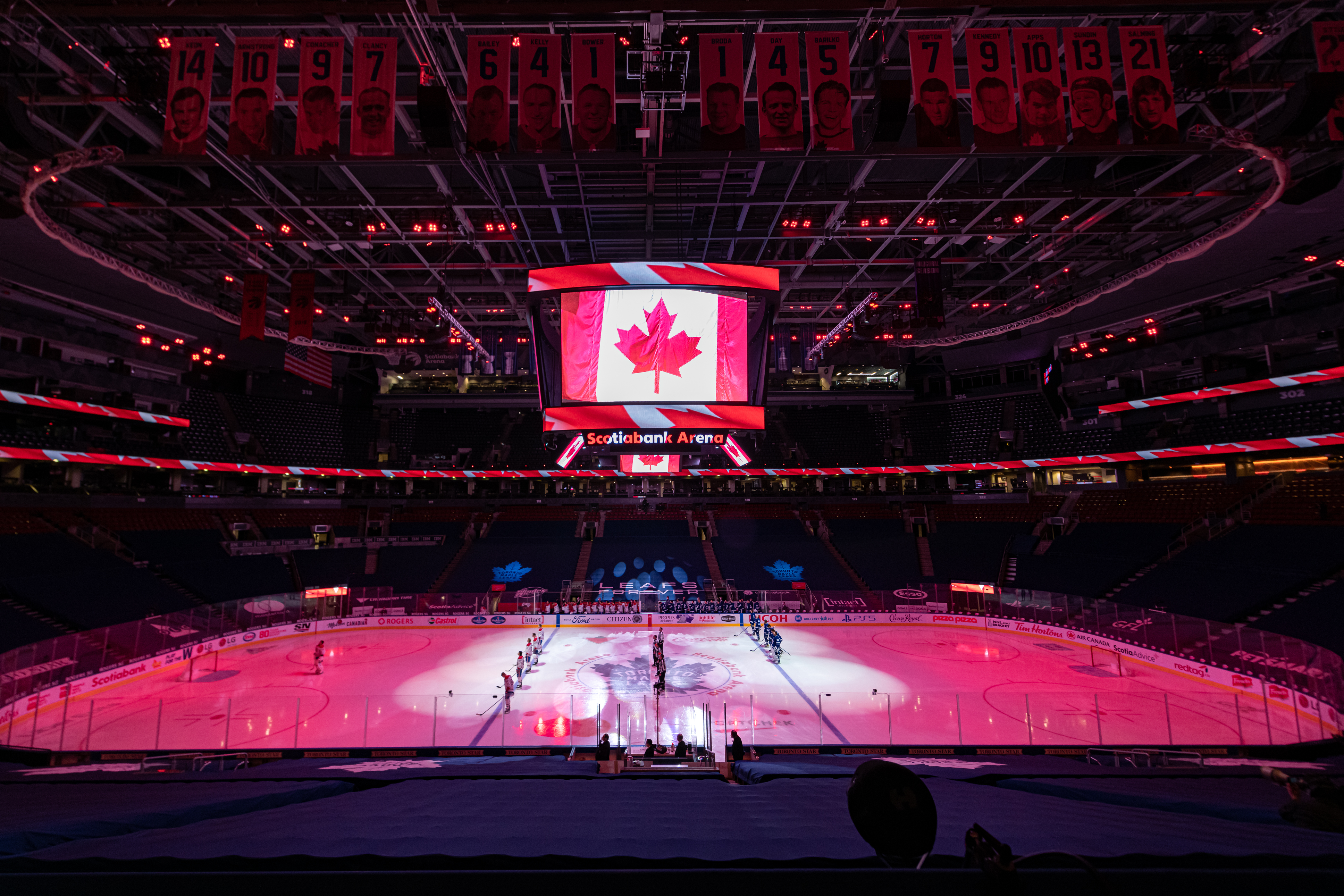 Montreal Canadiens and Toronto Maple Leafs players stand for the Canadian national anthem before the NHL regular season game between the Montreal Canadiens and the Toronto Maple Leafs on May 8, 2021, at Scotiabank Arena in Toronto, ON, Canada.