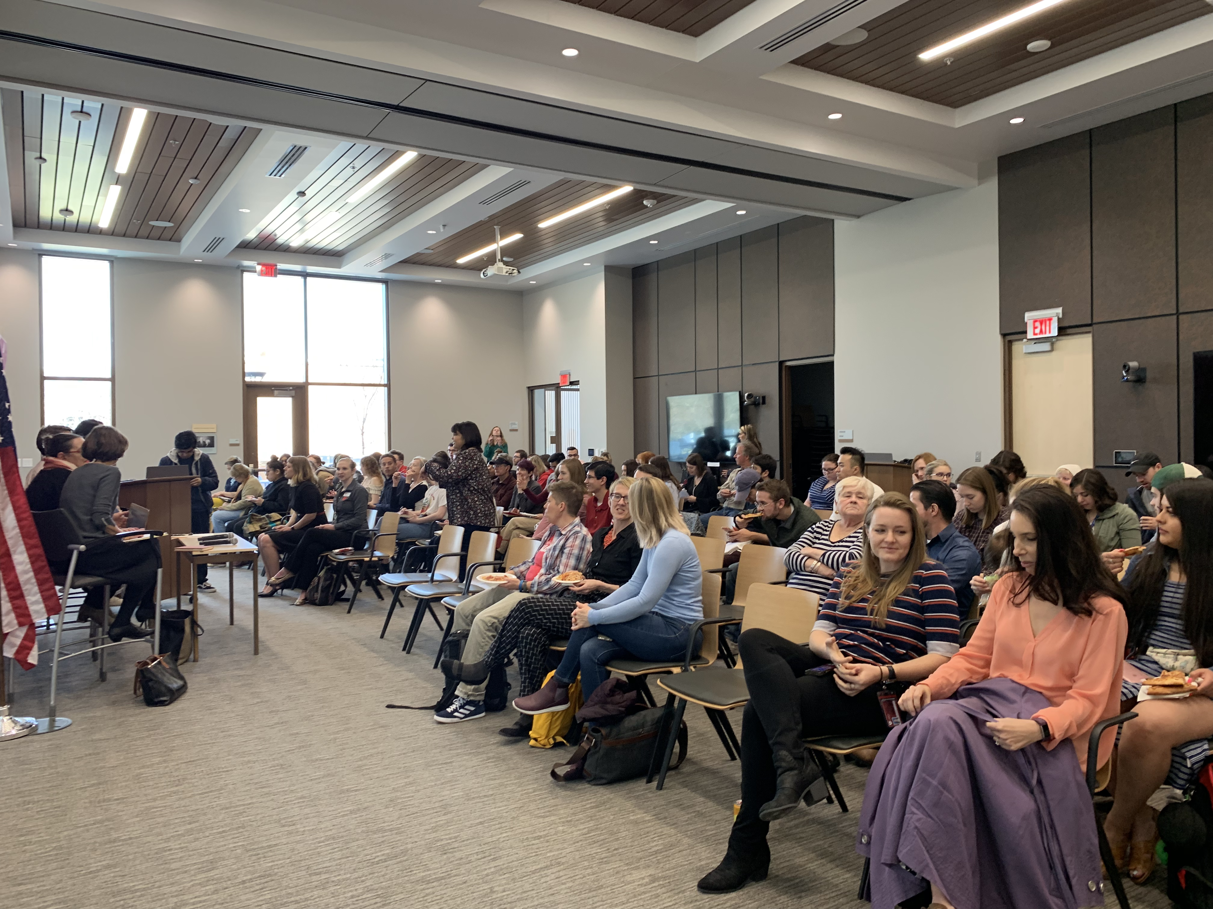A group attends a Hinkley Institute of Politics panel discussing Utah's gender wage gap on March 25, 2019.